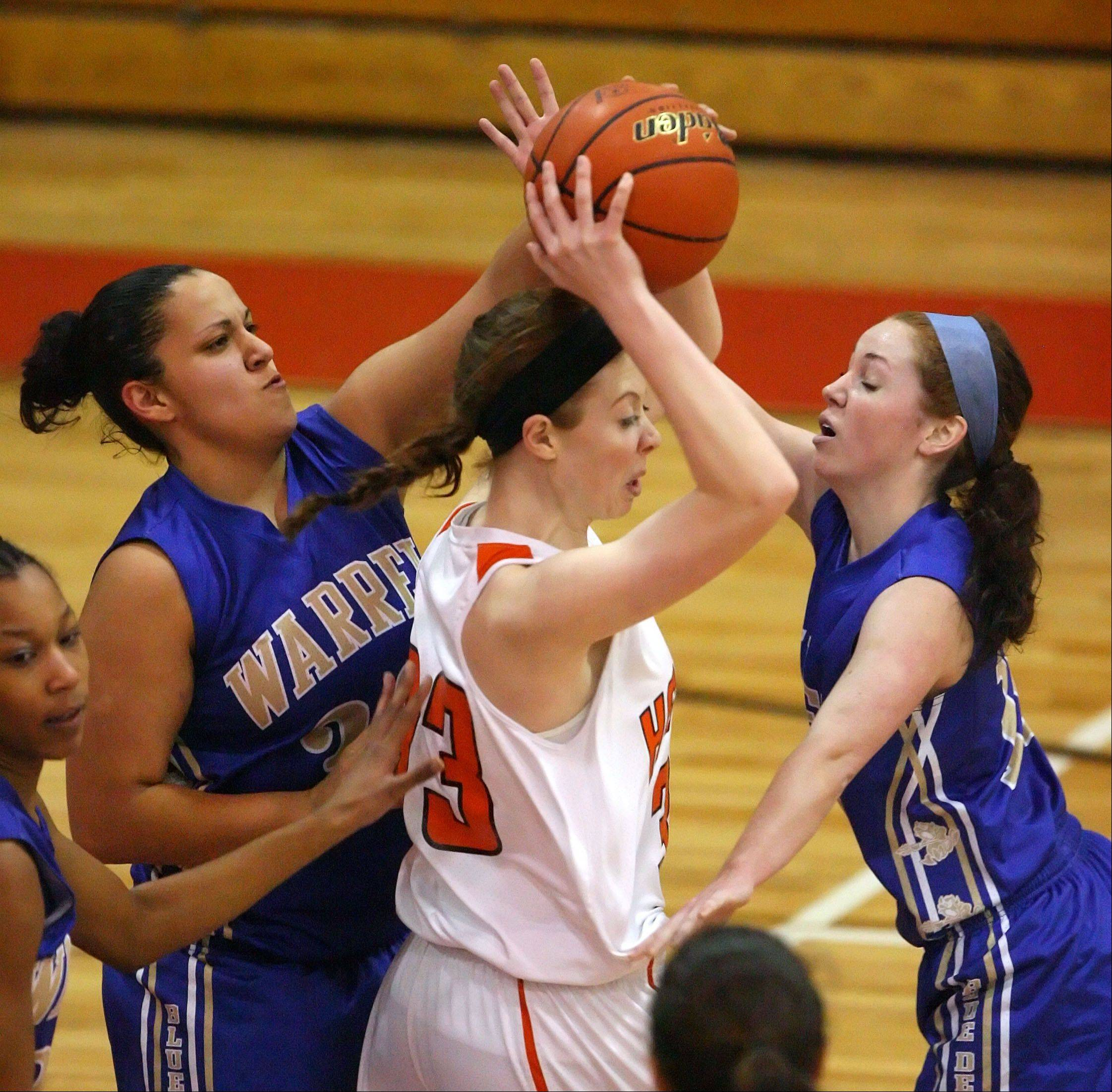 Warren's Jamie Stirling, left, and Rachel Brown double team Hersey's Ashley Raulli during Class 4A regional semifinal play Tuesday night at Mundelein.