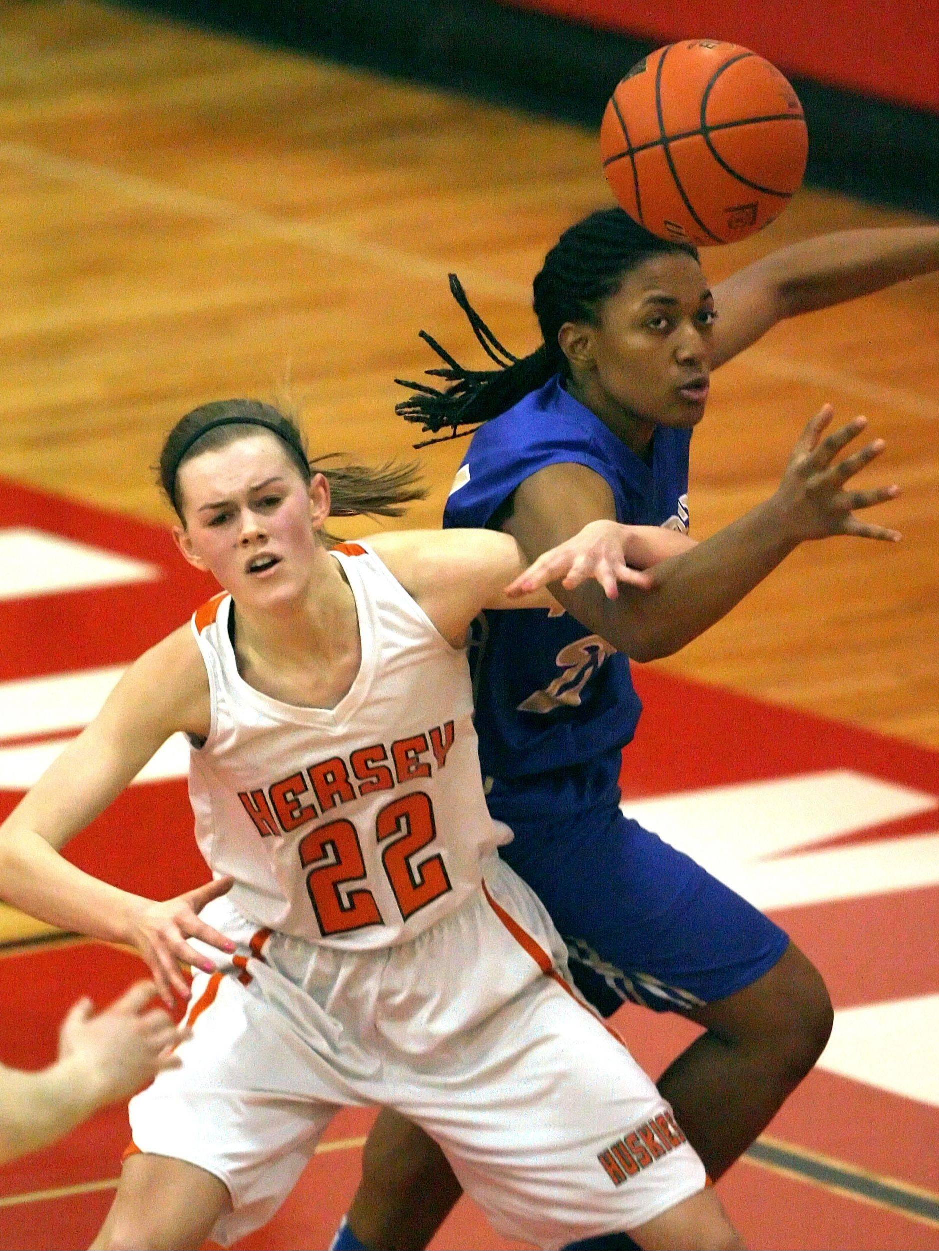 Hersey's Erica Hill, left, and Warren's Alyssa Phillips battle for a loose ball during Class 4A regional semifinal play Tuesday night at Mundelein.