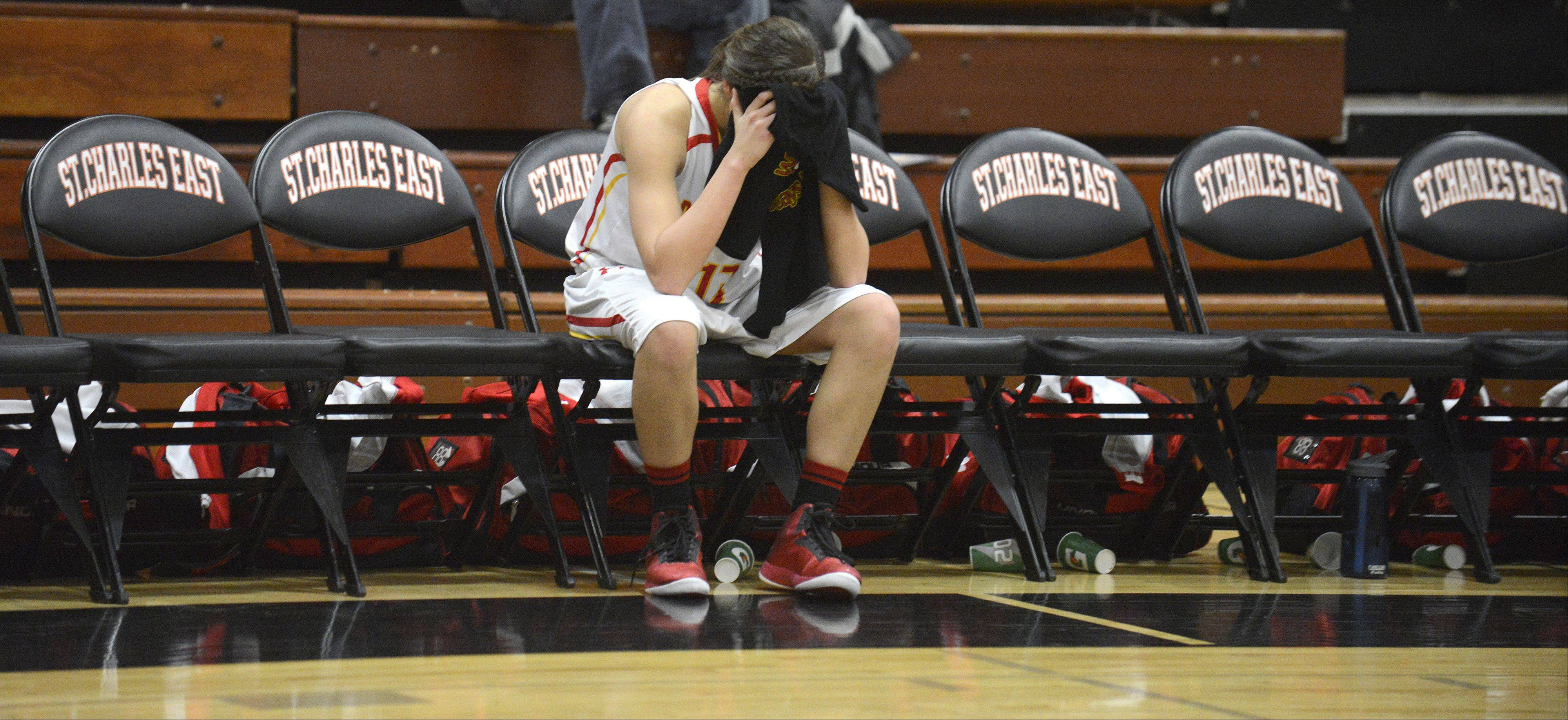 Laura Stoecker/lstoecker@dailyherald.comBatavia's Miranda Grizaffi sits on the bench as clock ticks down to the Bulldogs' loss to the St. Charles East Saints in the 4A regional on Tuesday, February 12.