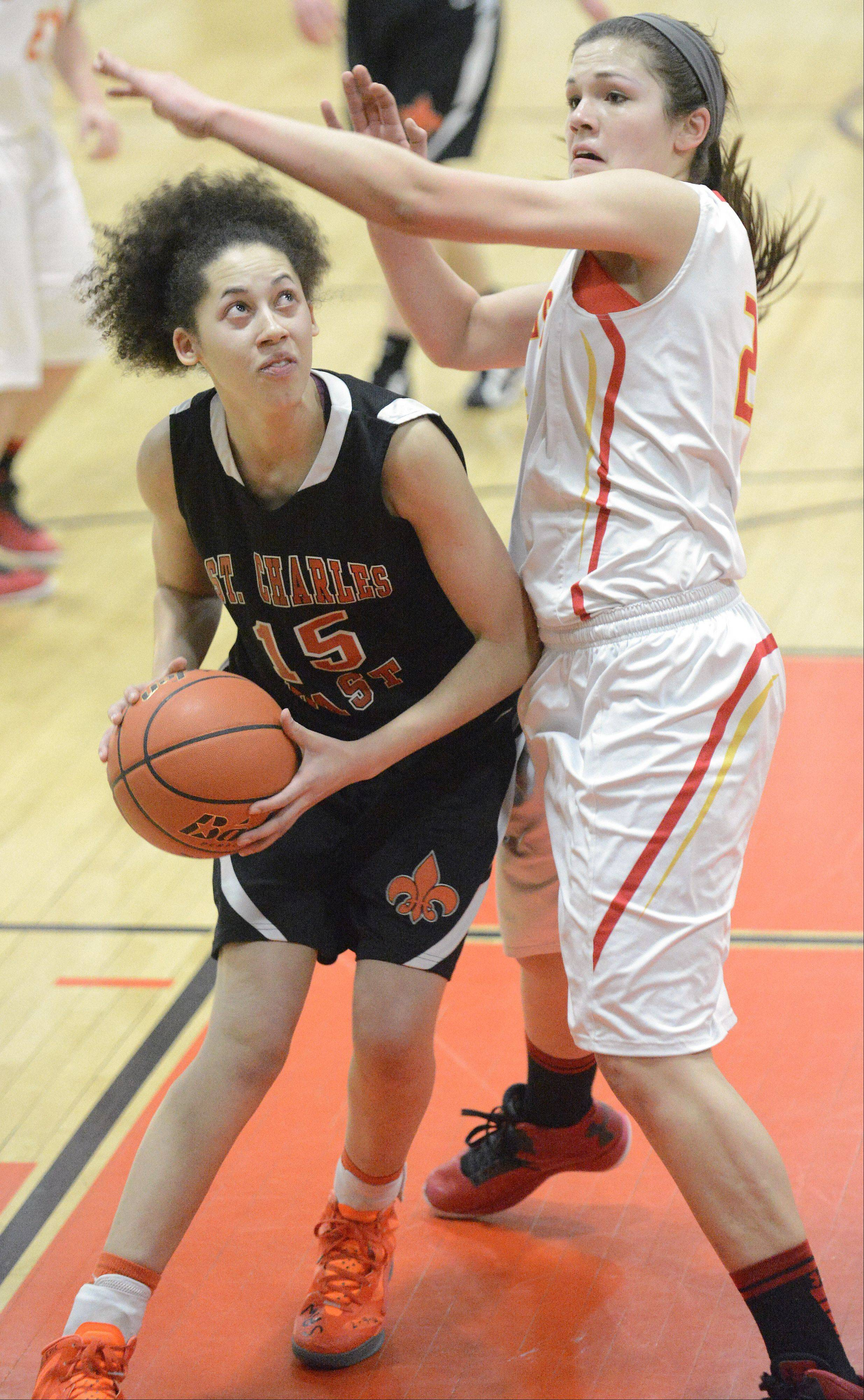Laura Stoecker/lstoecker@dailyherald.com St. Charles East's Kyra Washington maneuvers around a block by Batavia's Hannah Frazier in the first quarter of the 4A regional on Tuesday, February 12.