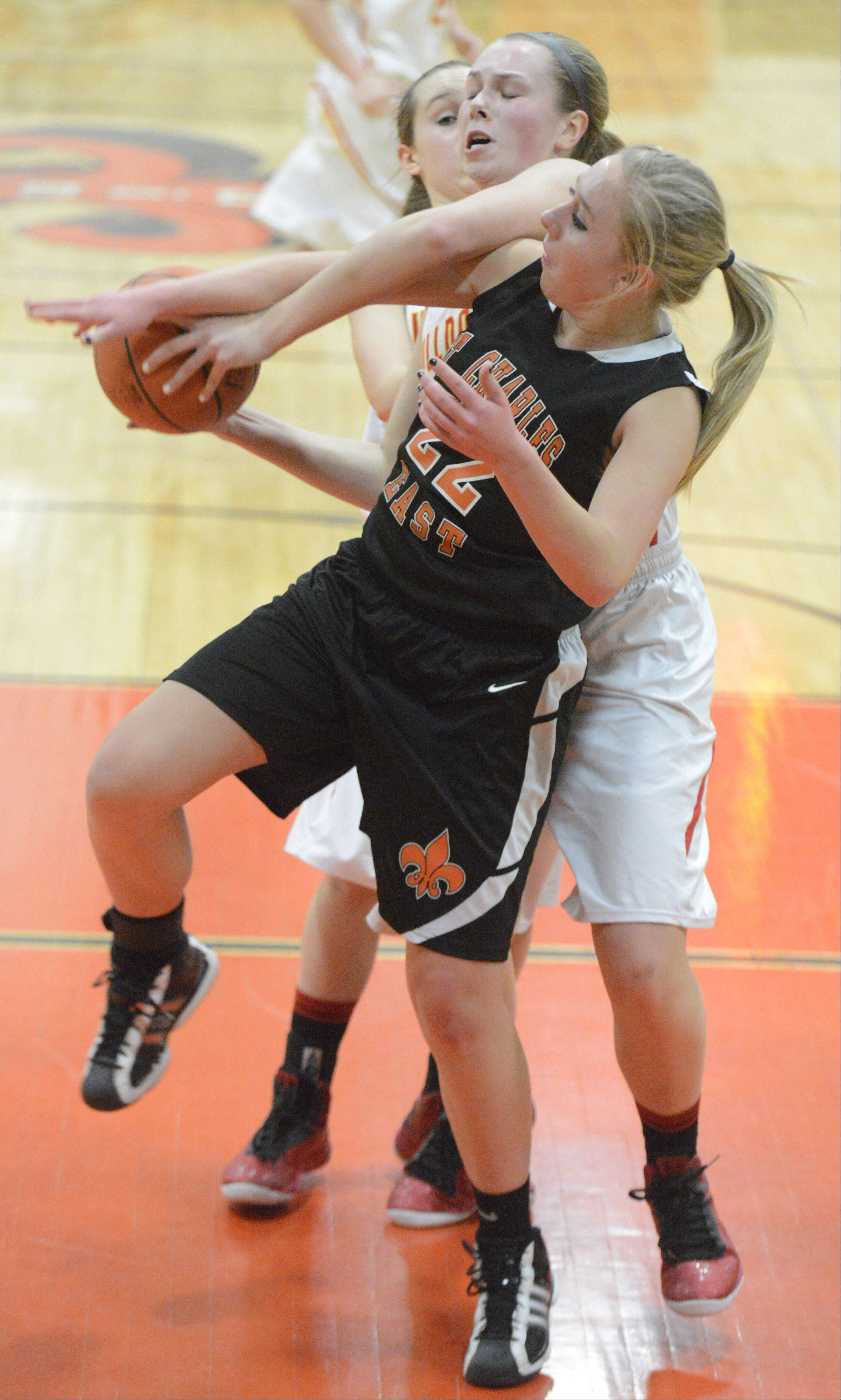 Laura Stoecker/lstoecker@dailyherald.com St. Charles East's Anna Bartels and Batavia's Erin Bayram struggle for a rebound in the second quarter of the 4A regional on Tuesday, February 12.