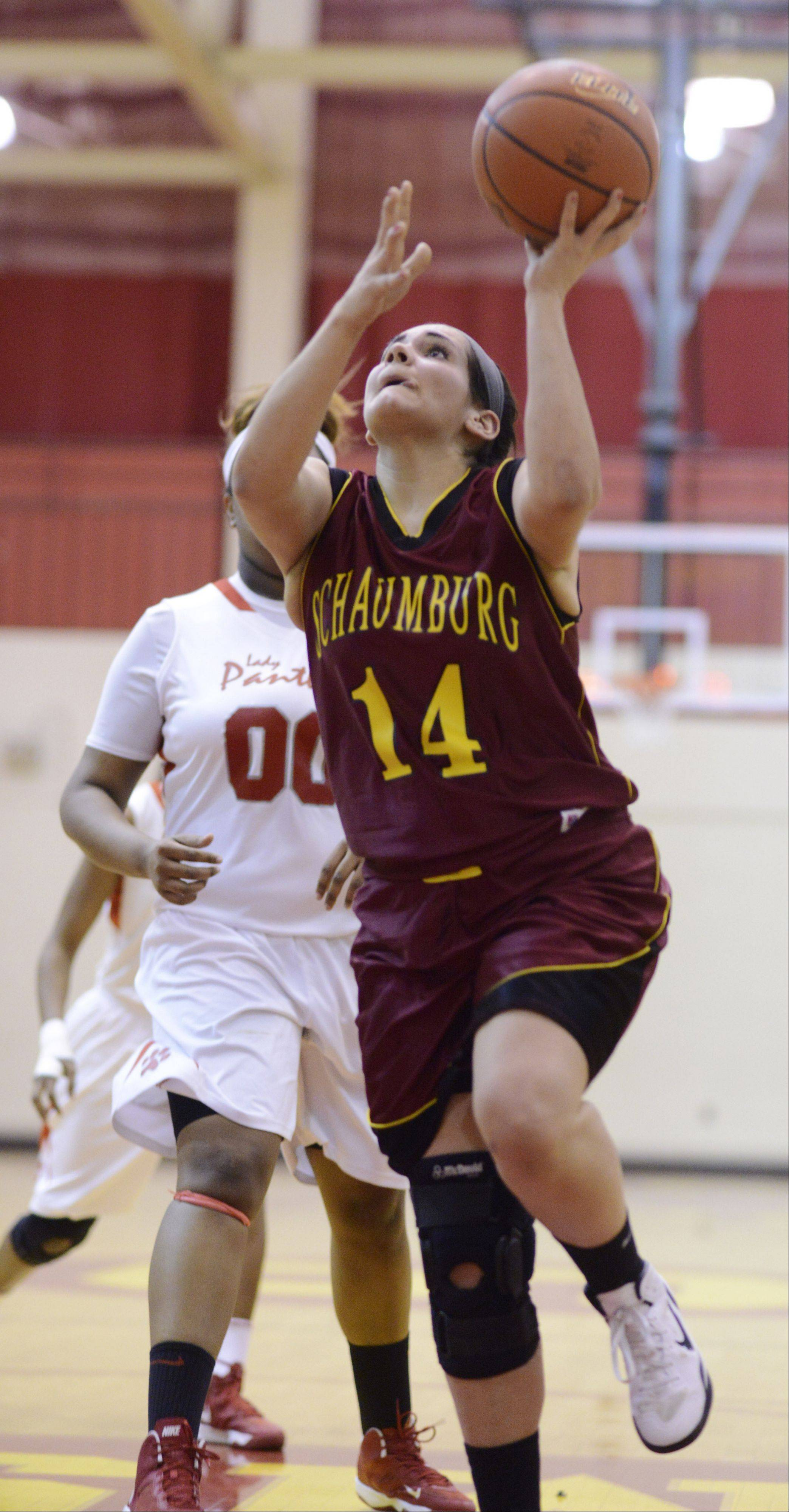 Schaumburg's Carly Brossard drives to the basket during Tuesday's Class 4A regional semifinal against Proviso West.