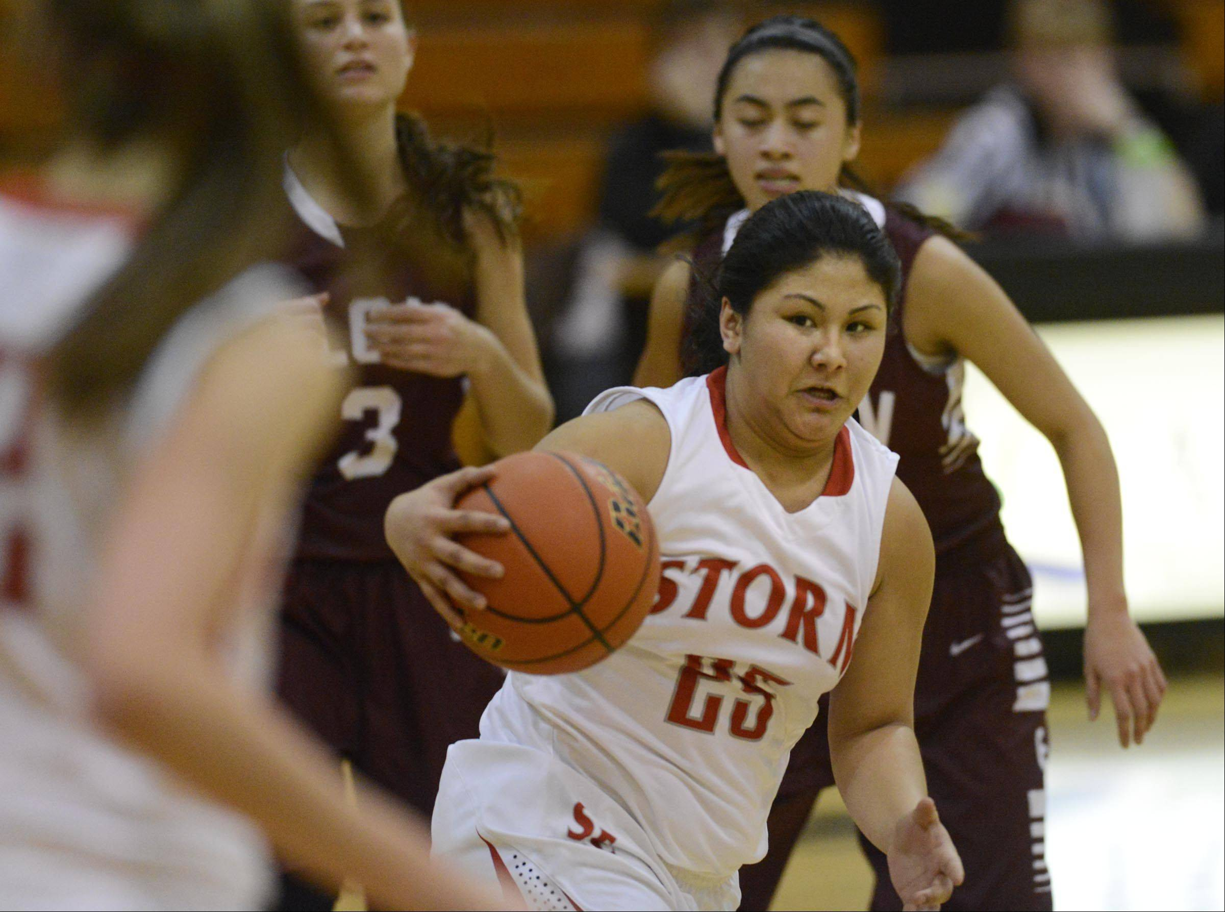 South Elgin's Nadia Yang looks for a teammate in Tuesday's Class 4A regional semifinal game against Elgin in Streamwood.