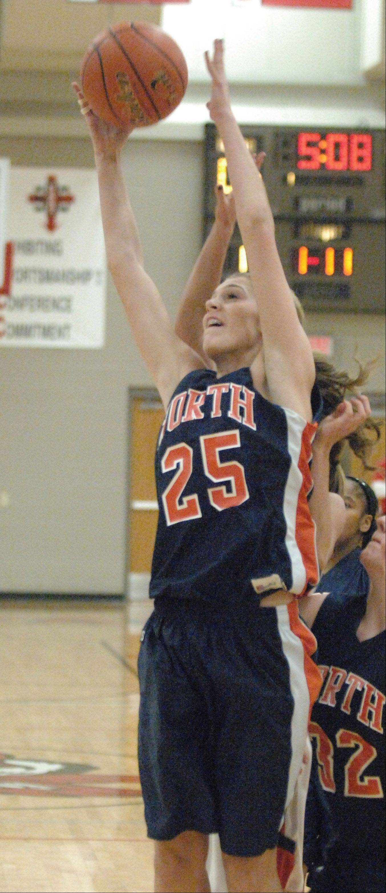 Kayla Sharples of Naperville North goes up for a rebound.