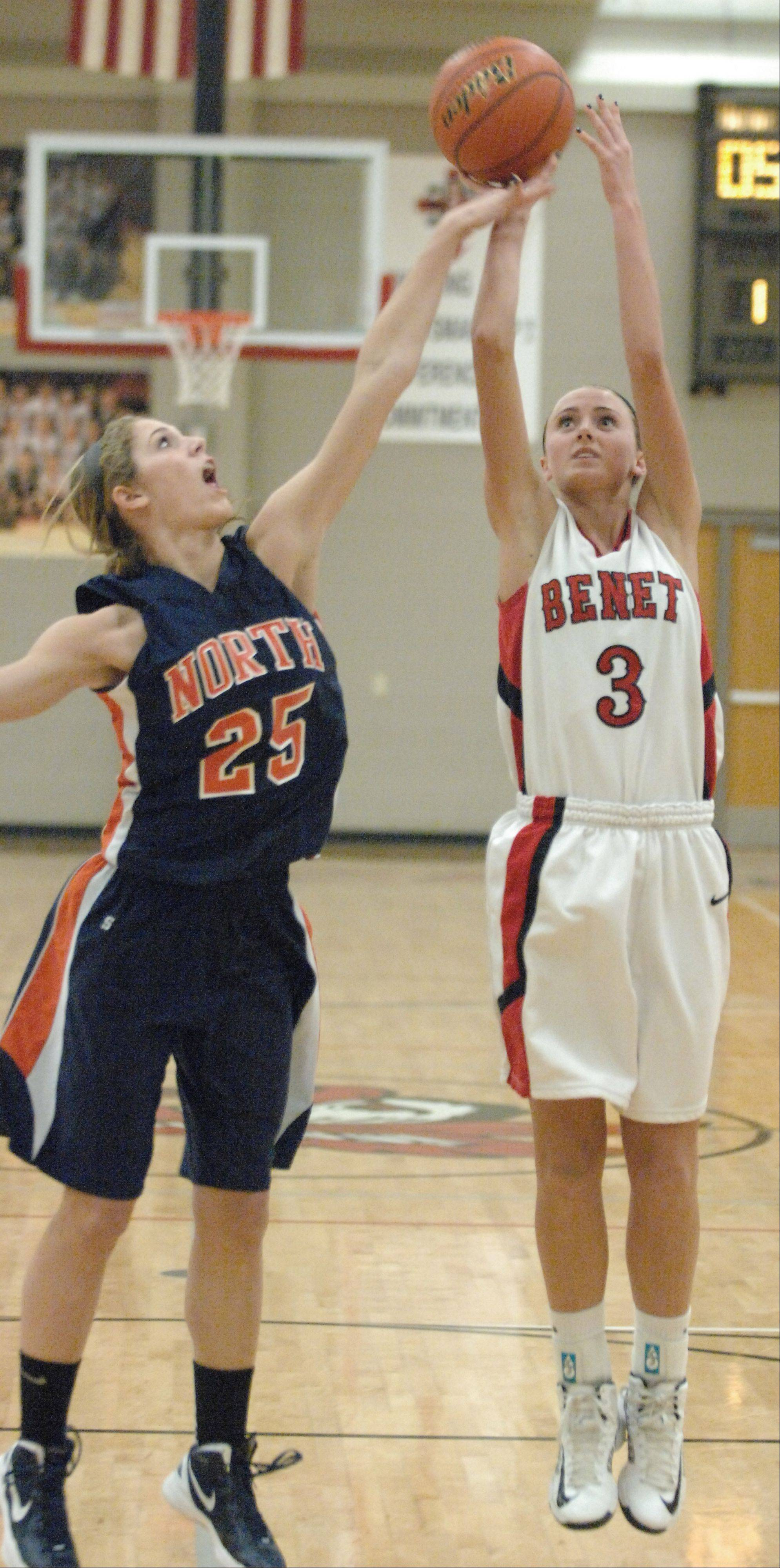 Kayla Sharples of Naperville North and Christen Prasse of Benet go up for a rebound.