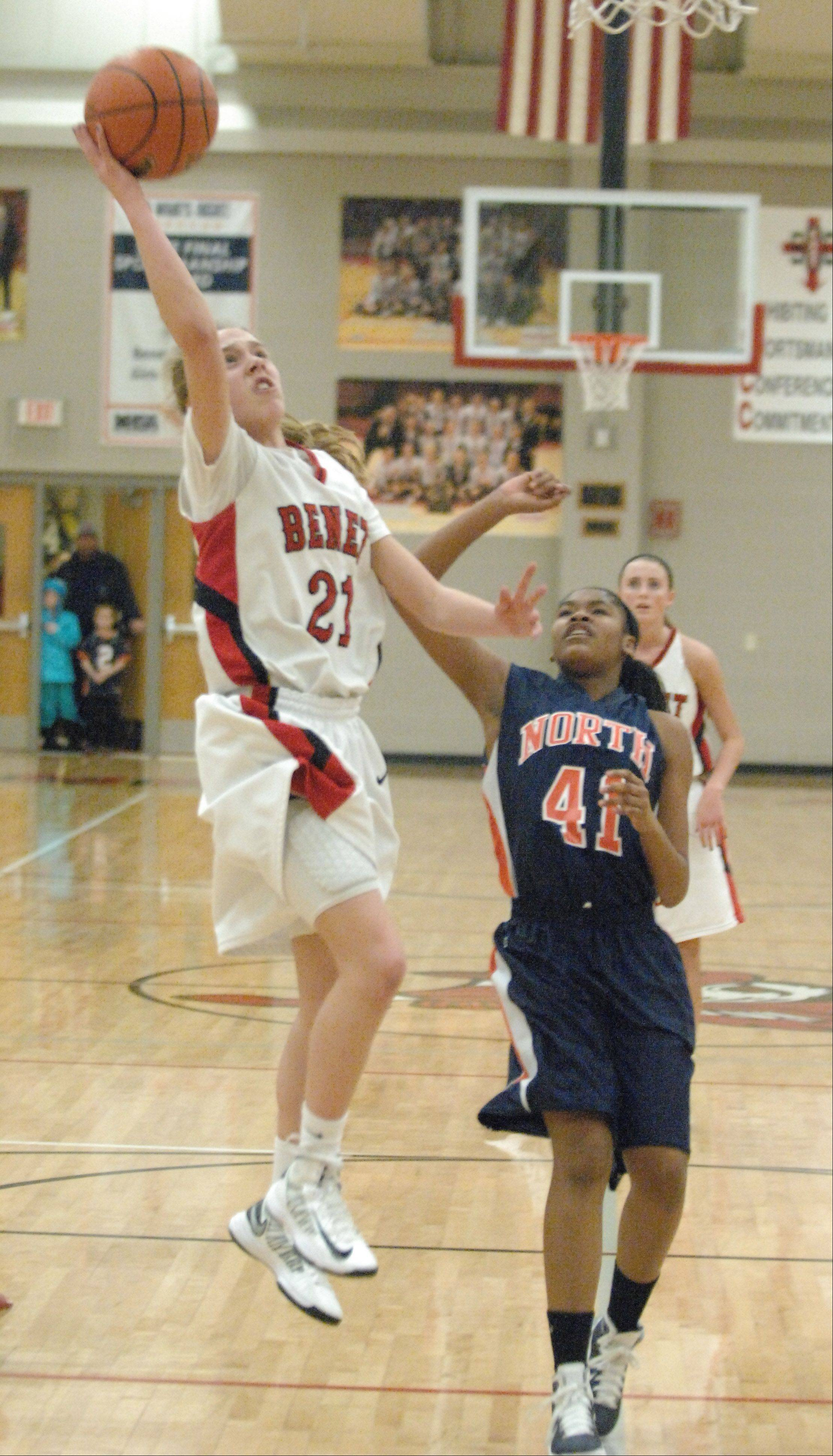 Kathleen Doyle of Benet, left, puts up a shot while Cece Pope of Naperville North blocks.