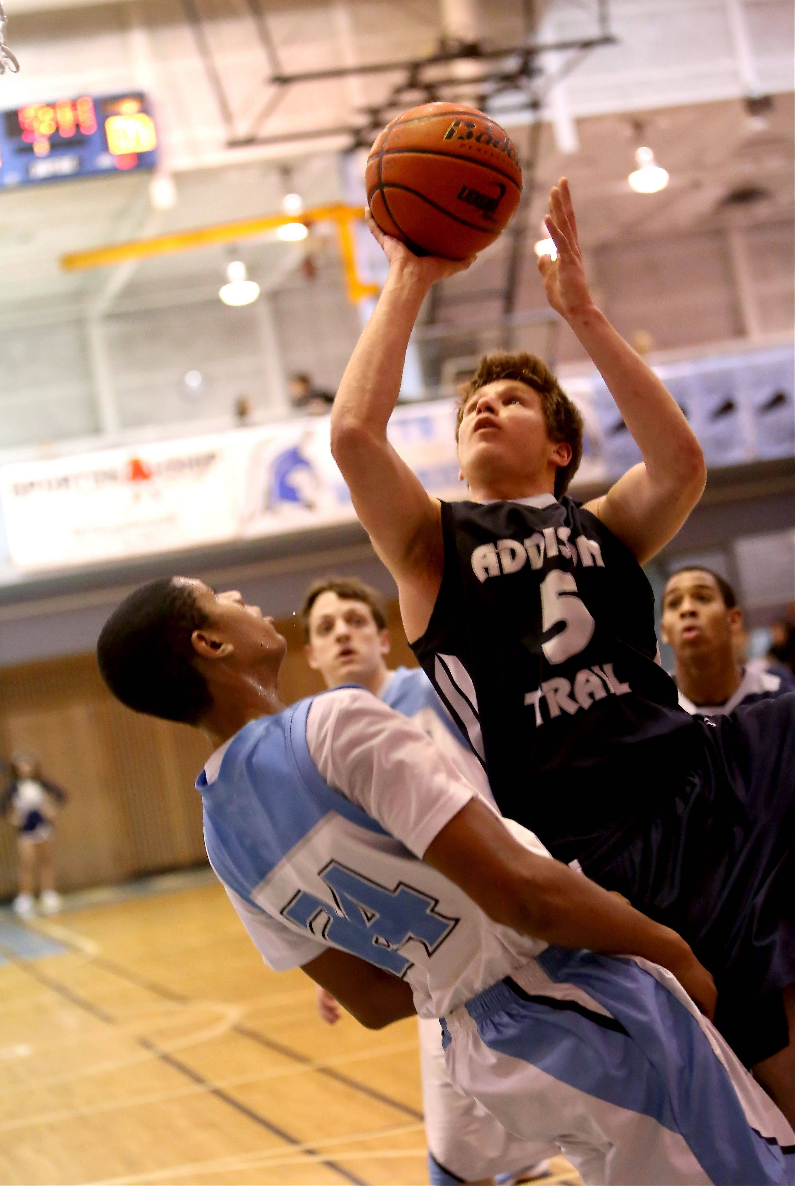 James Pupillo of Addison Trail, right, attempts a basket as he runs into Kyle Rushing of Willowbrook , left.
