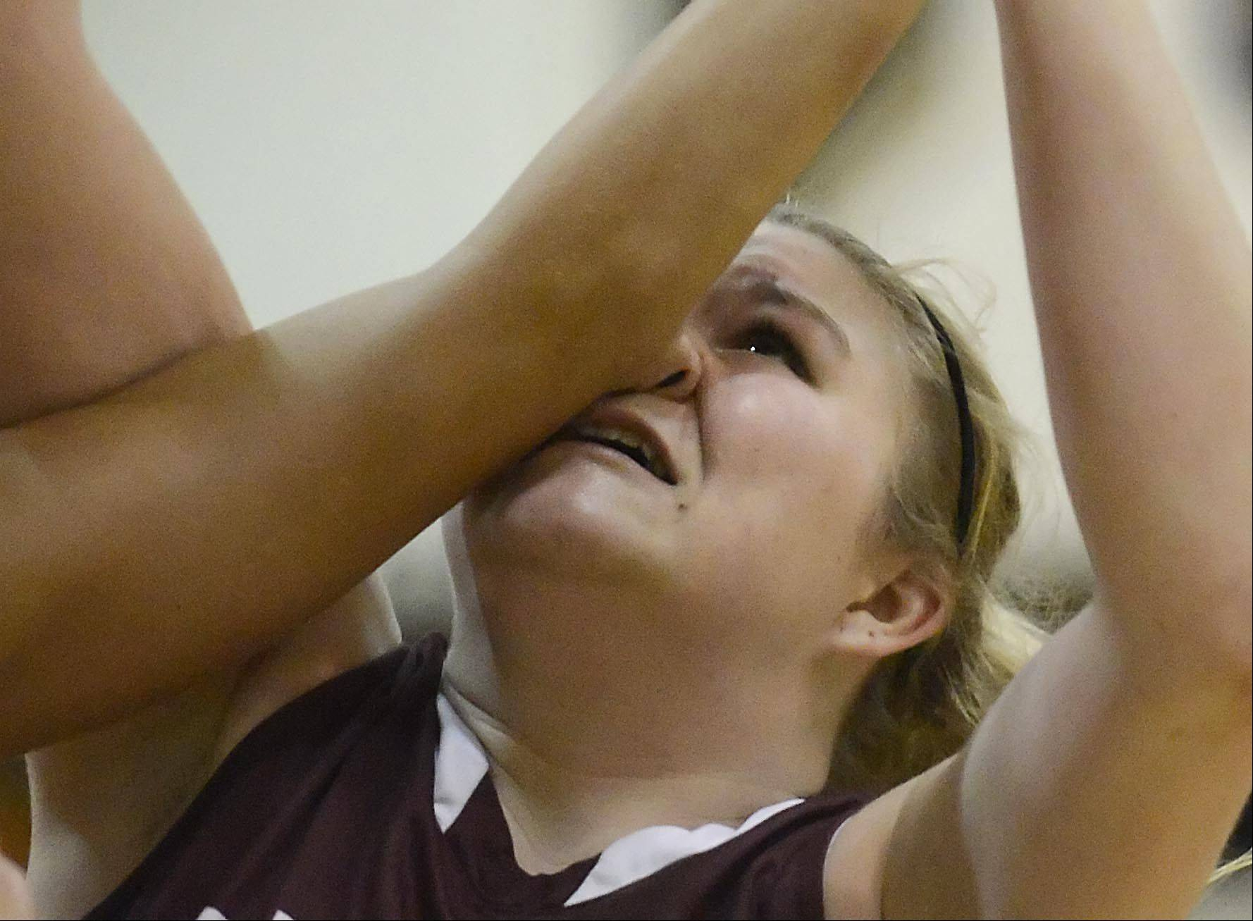 Elgin's Destiny West gets an elbow to the nose against South Elgin.