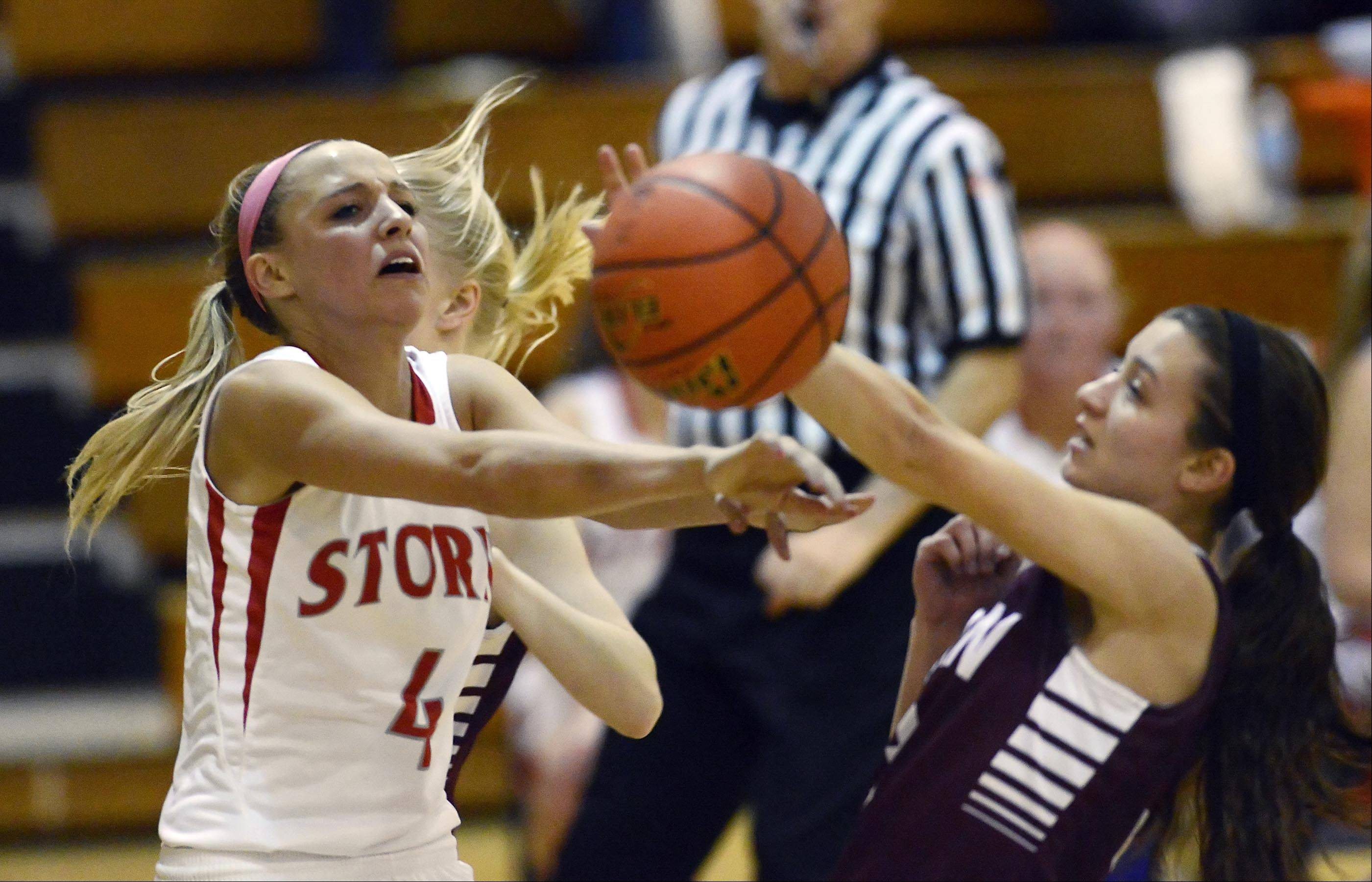 Elgin's Maggie Powers and South Elgin's Savanah Uveges collide as Uveges drives to the basket.