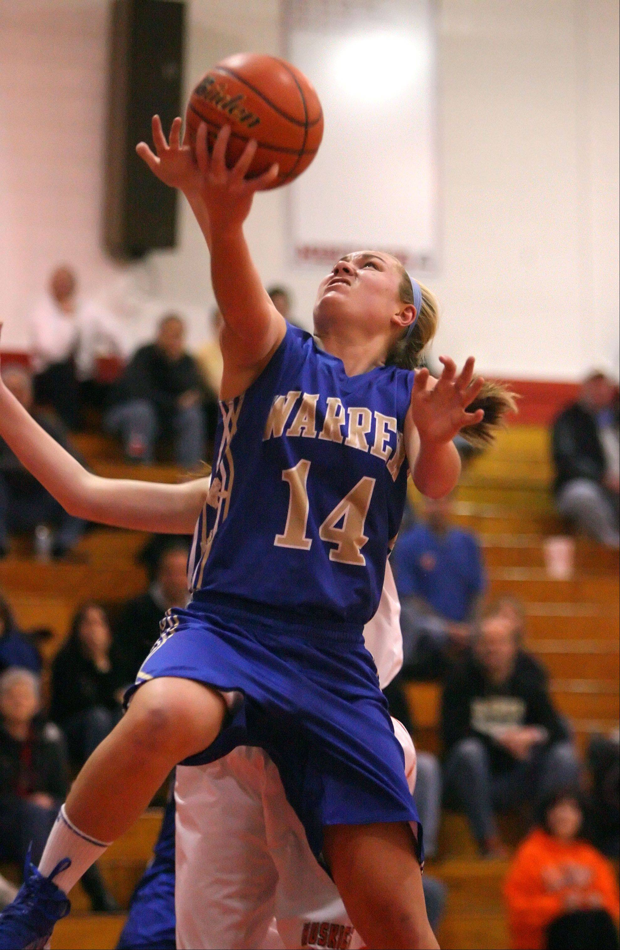 Warren's Kristen O'Brien drives to the hoop.