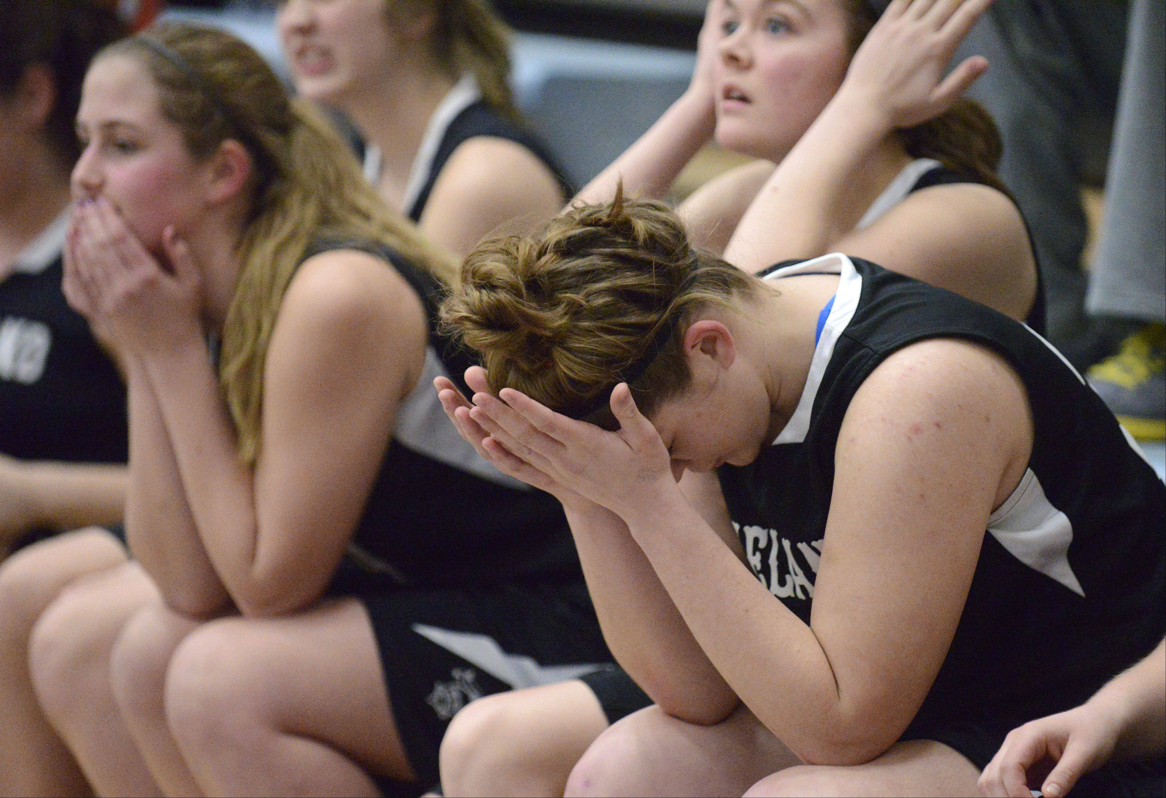 Kaneland's Brittany Kemp holds her head in her hands after a missed shot in the final seconds of the Class 3A regional game vs. Plano on Wednesday, February 13. 35