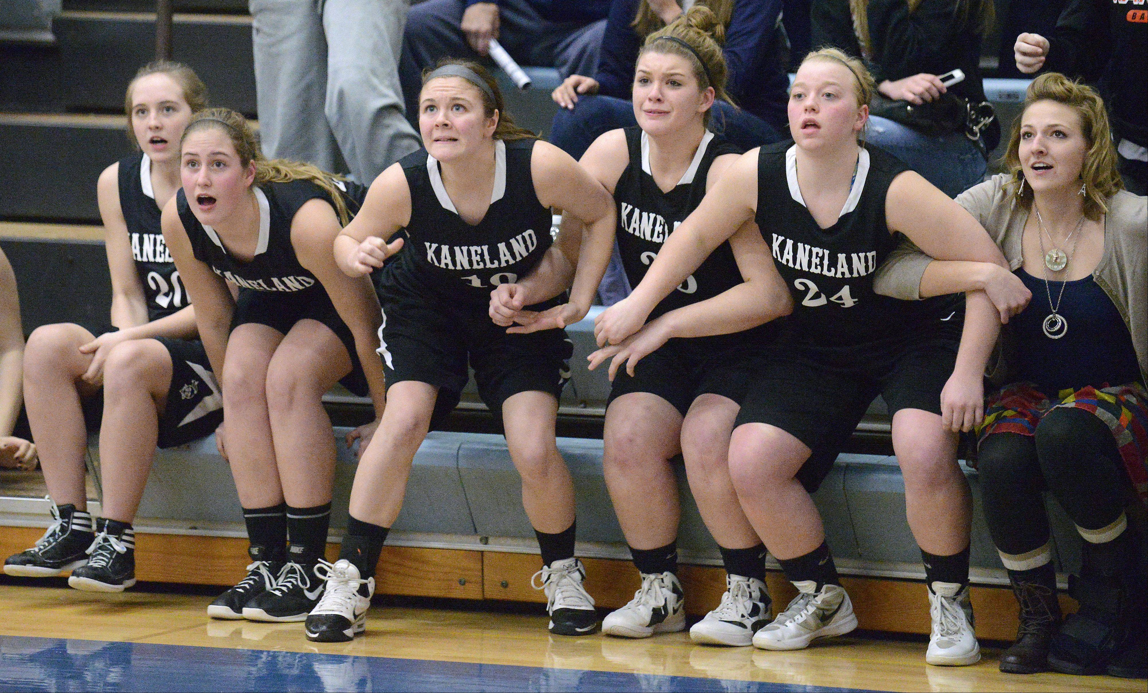 Kaneland's Ally VanBogaert, Katherine Brinkman, Brittany Kemp, and Amber Winquist Bailey lean forward with linked in arms as they watch one of the final baskets in the Class 3A regional game on Wednesday, February 13. The Knights rallied hard in the second half, but lost by just one point.