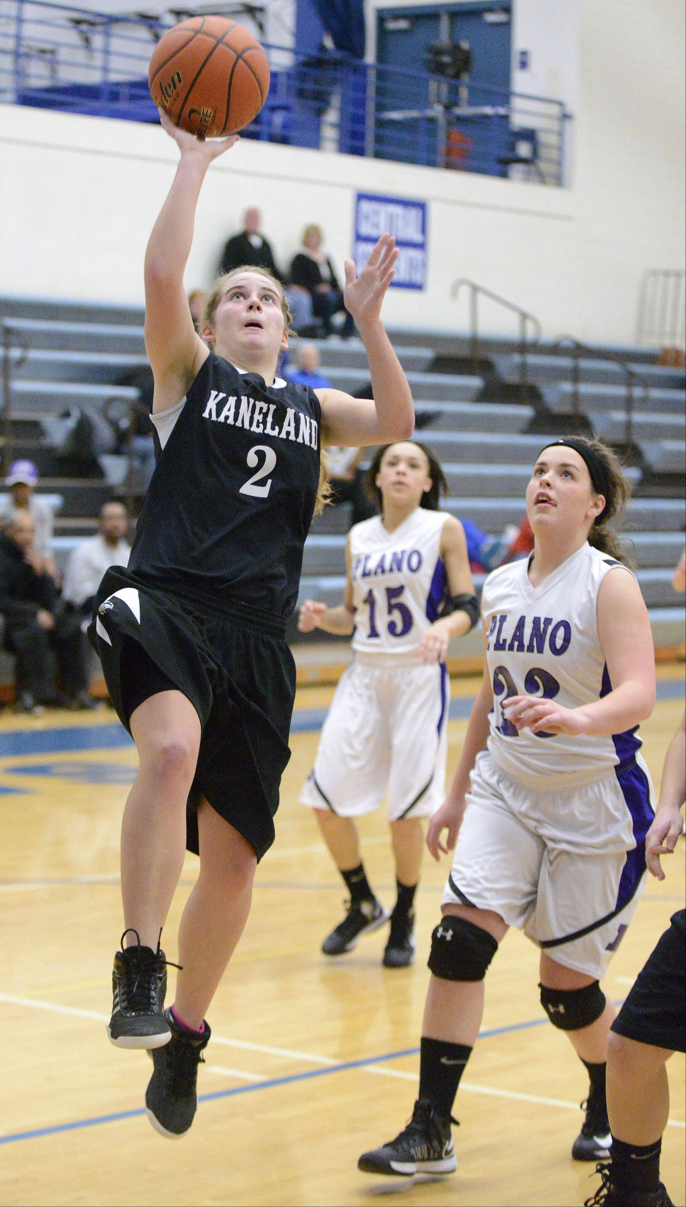 Kaneland's Sarah Grams sinks a shot past Plano's Clarisa Martinez in the fourth quarter of the Class 3A regional game on Wednesday, February 13.