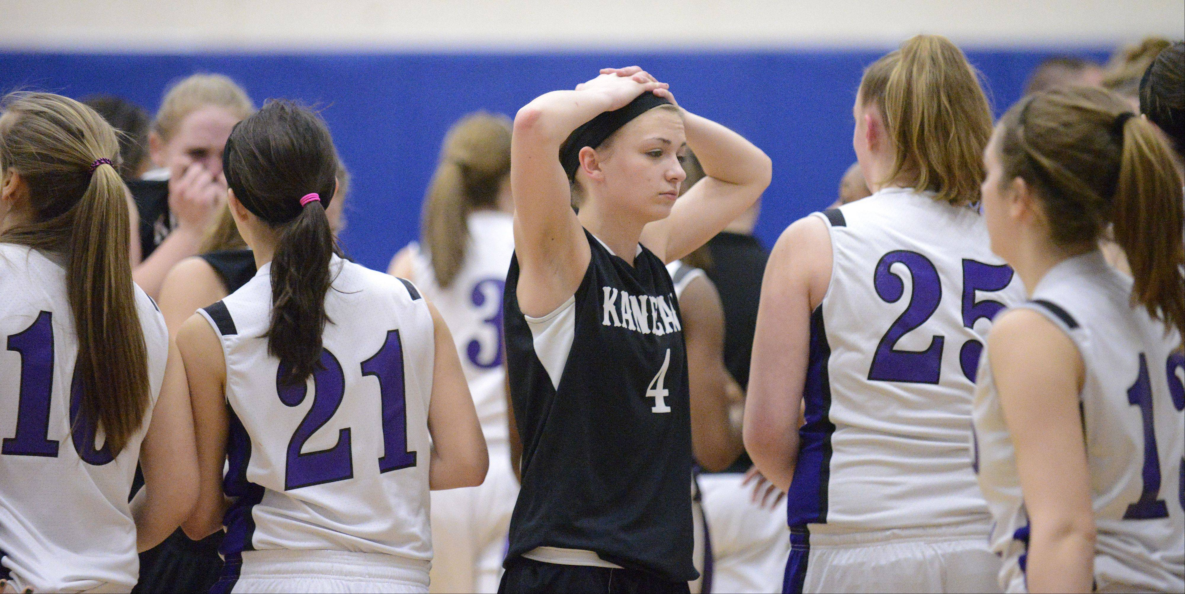 Kaneland's Caroline Heimerdinger makes her way through Plano players after the Knights loss in the Class 3A regional game on Wednesday, February 13.