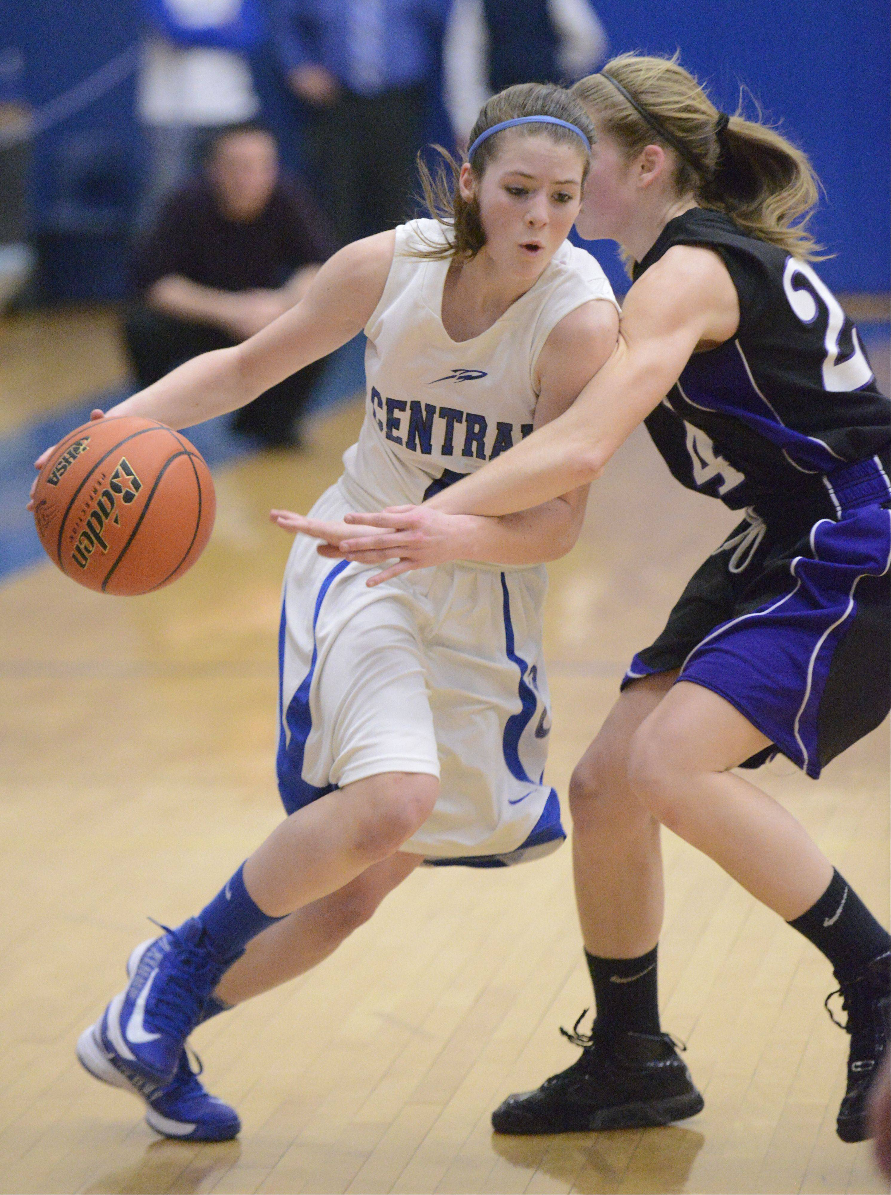 Burlington Central's Kayla Ross, left, works against the defense of Hampshire's Nikki Dumoulin Wednesday night during Class 3A regional action at Burlington.