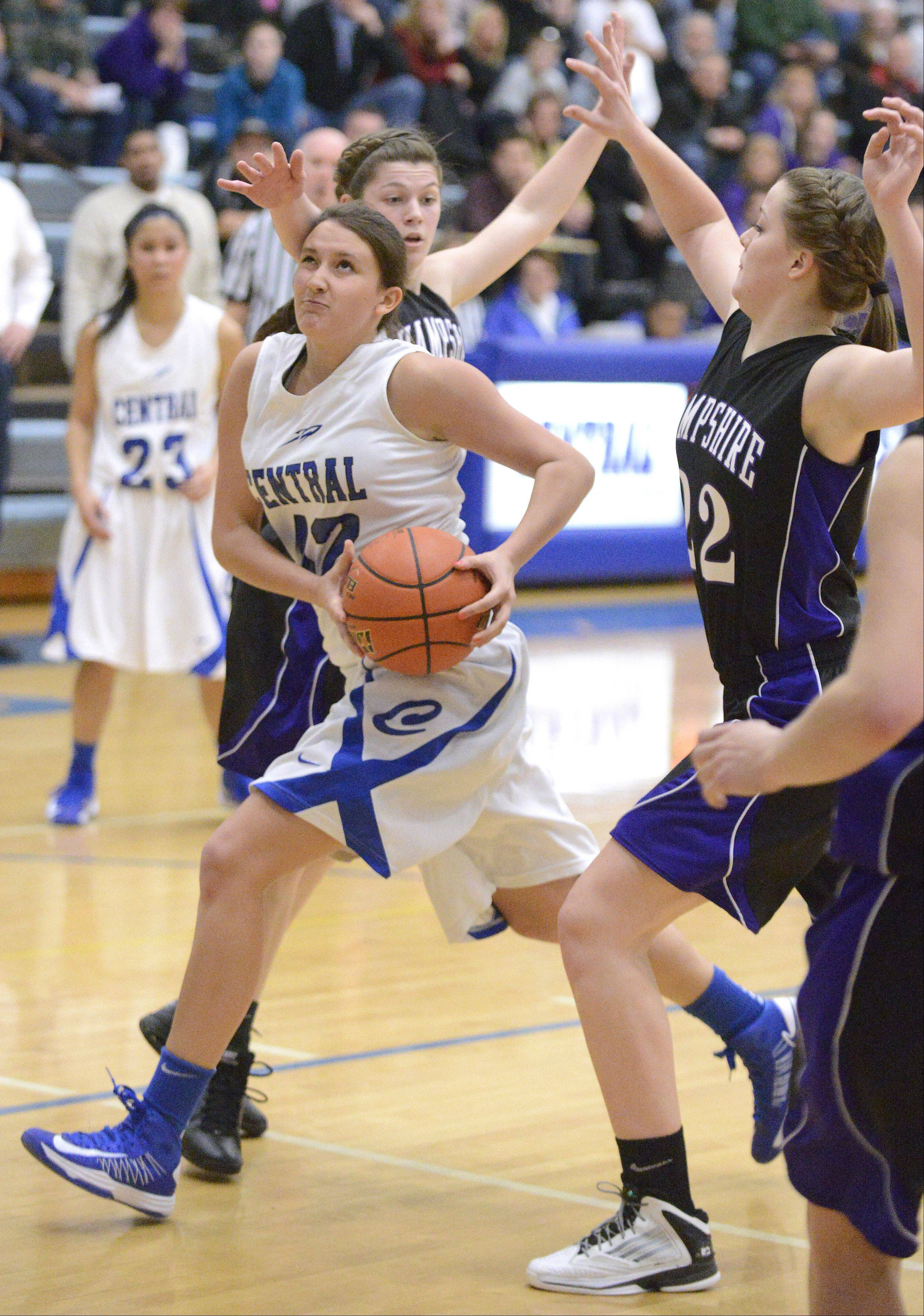 Burlington Central's Alison Colby plows past a block by Hampshire's Tricia Dumoulin in the fourth quarter.