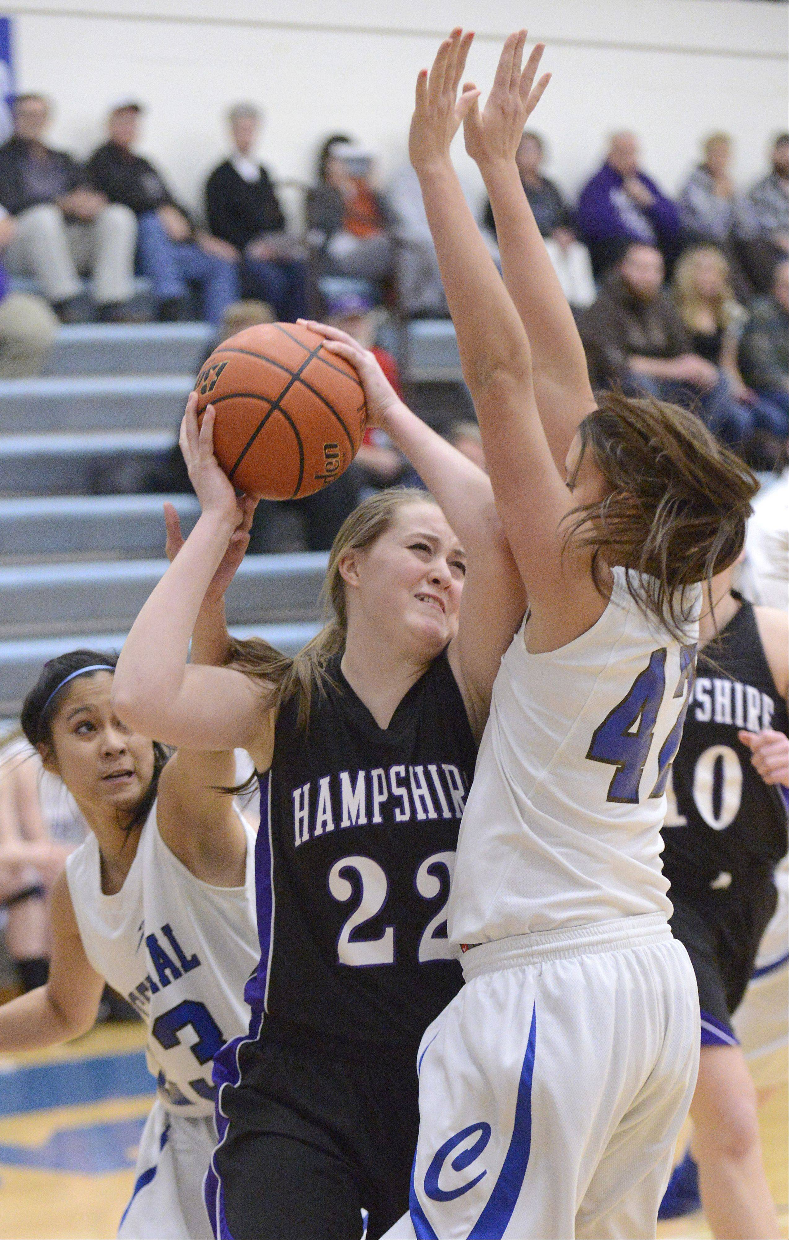 Hampshire's Emma Benoit is smothered by Burlington Central's Camille Delacruz and Alison Colby in the first quarter.