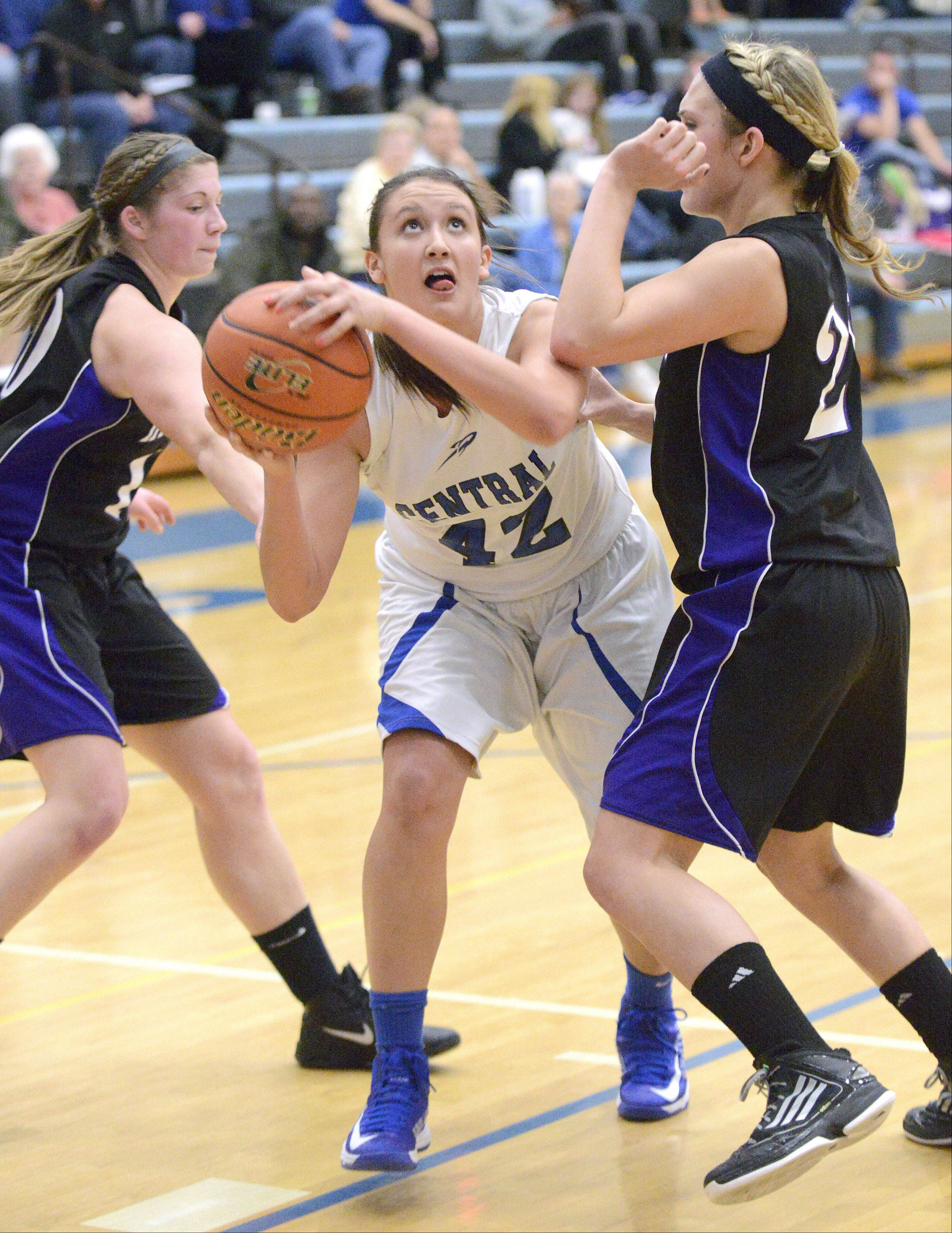 Burlington Central's Alison Colby takes a shot around a block by Hampshire's Lizzy Panzica in the second quarter.