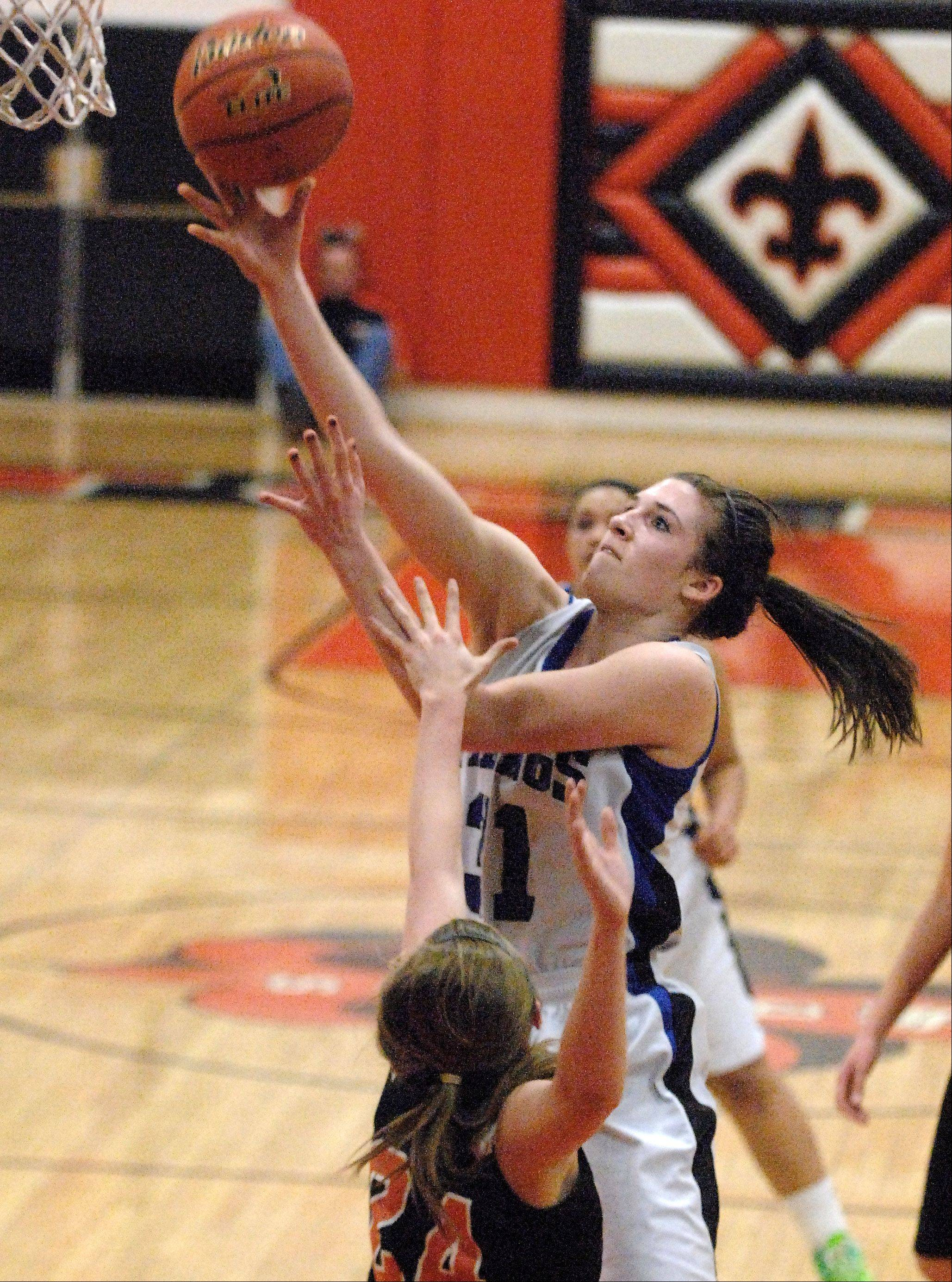 Geneva's Sami Pawlak scores over St. Charles East's Laney Deckrow.