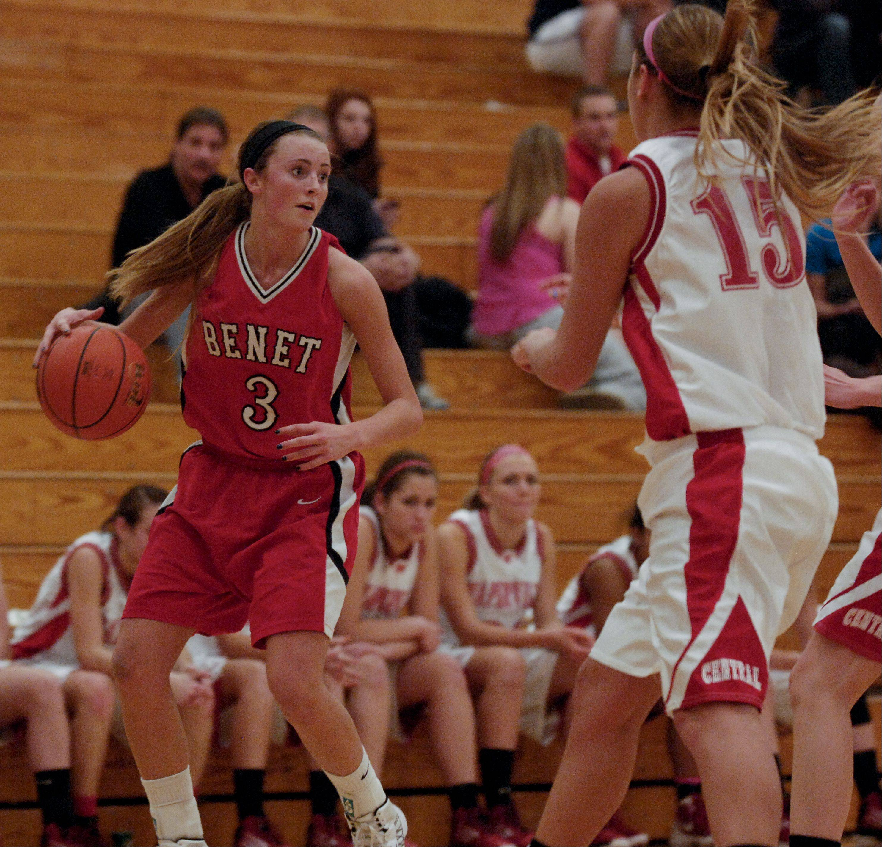 Christen Prasse of Benet Academy looks for an opening during the girls Class 4A regional final basketball game against Naperville Central, Thursday in Lisle.