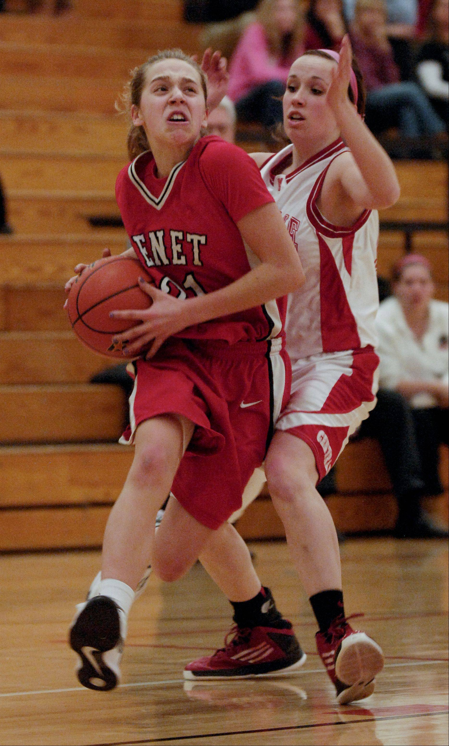 Kathleen Doyle of Benet Academy drives around Emily Kraft of Naperville Central during the girls Class 4A regional final basketball game, Thursday in Lisle.