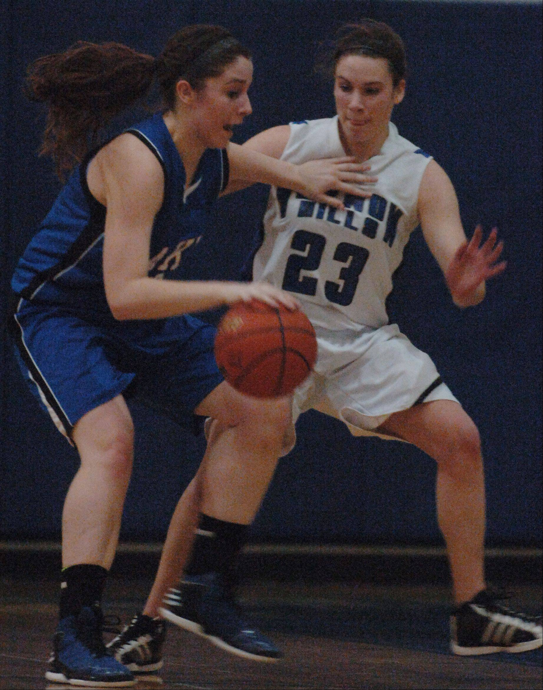 Paul Valade/pvalade@dailyherald.comLakes' Terese McMahon, left, keeps Vernon Hills' Brie Bahlmann at arm's length during Thursday's Class 3A basketball regional final in Lake Villa.