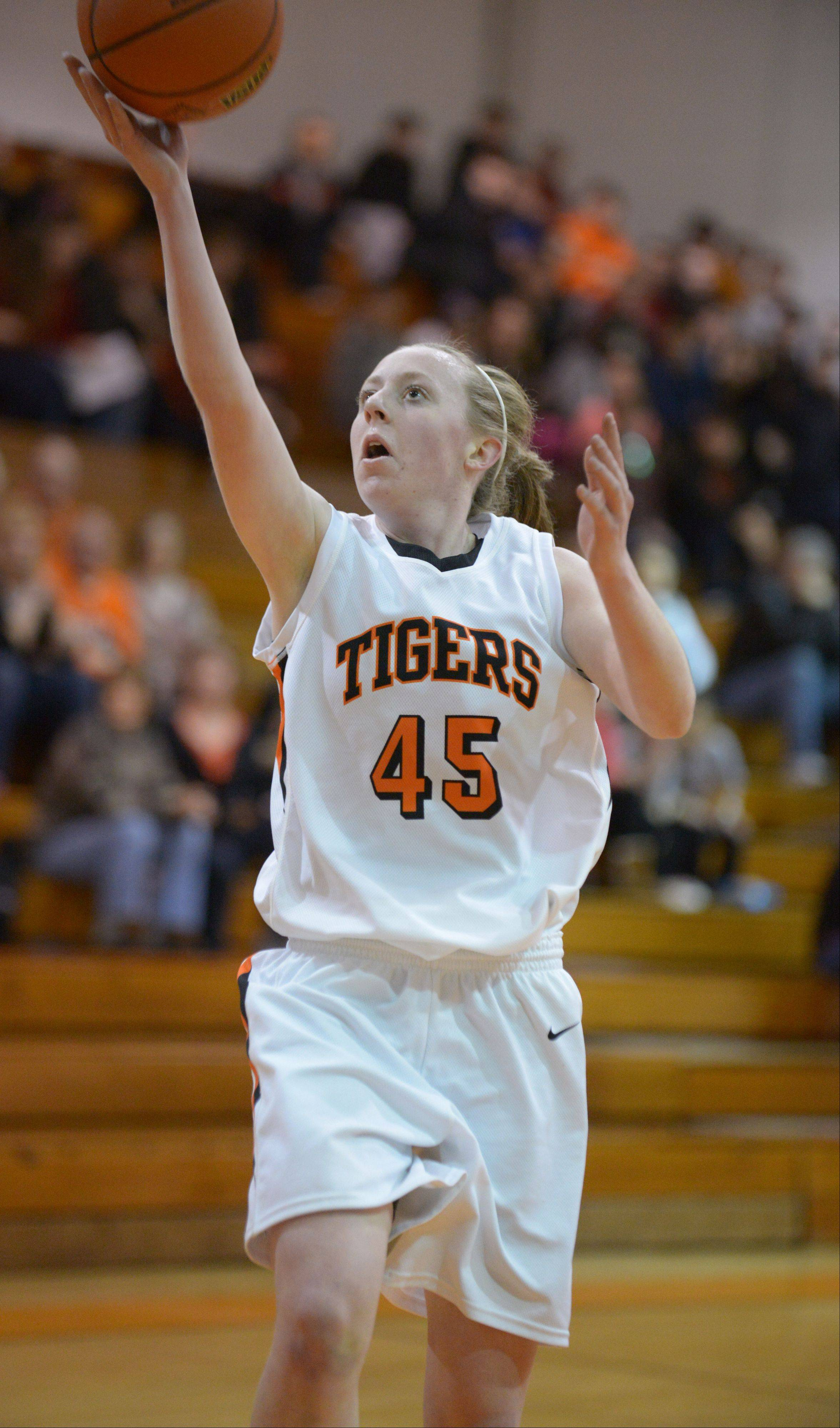 Meghan Waldron of Wheaton Warrenville South on the breakaway during the York at Wheaton Warrenville South girls basketball Class 4A girls regional final game.
