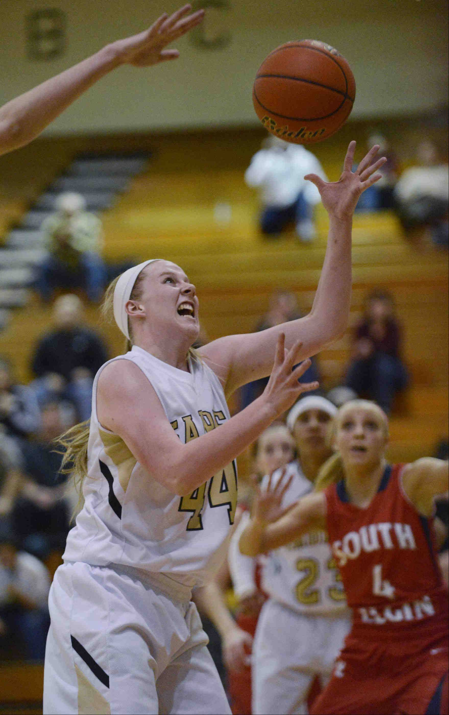 Streamwood's Hannah McGlone grabs a rebound against South Elgin in the Class 4A regional championship game Thursday in Streamwood.