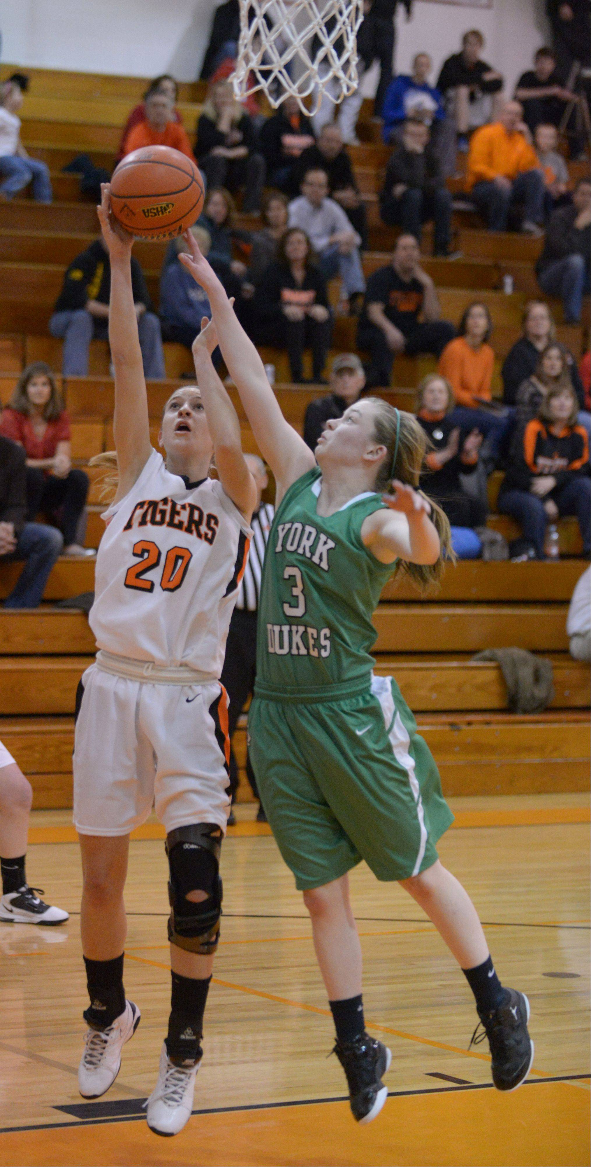 Kelly Langlas of Wheaton Warrenville south,left, and AnnaBell Lansdowne of York go for a rebound.
