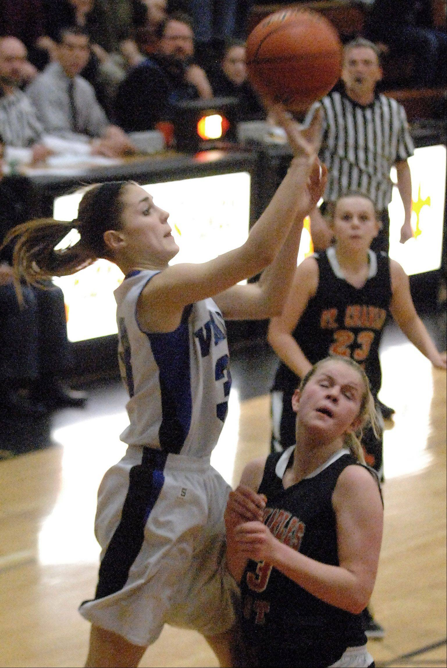 Geneva's Madeline Dunn scores as the third quarter ends.
