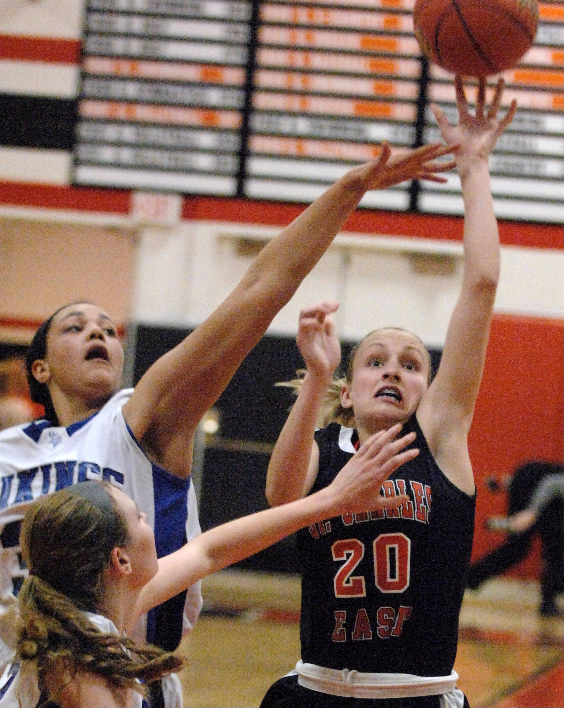St. Charles East's Katie Claussner scores against Geneva.