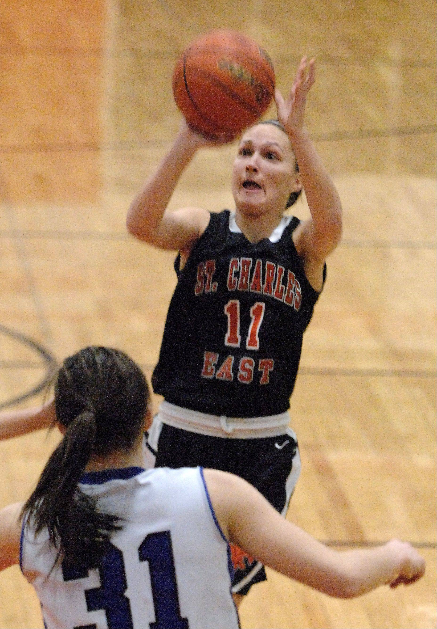 St. Charles East's Carly Pottle scores over Geneva's Sami Pawlak.