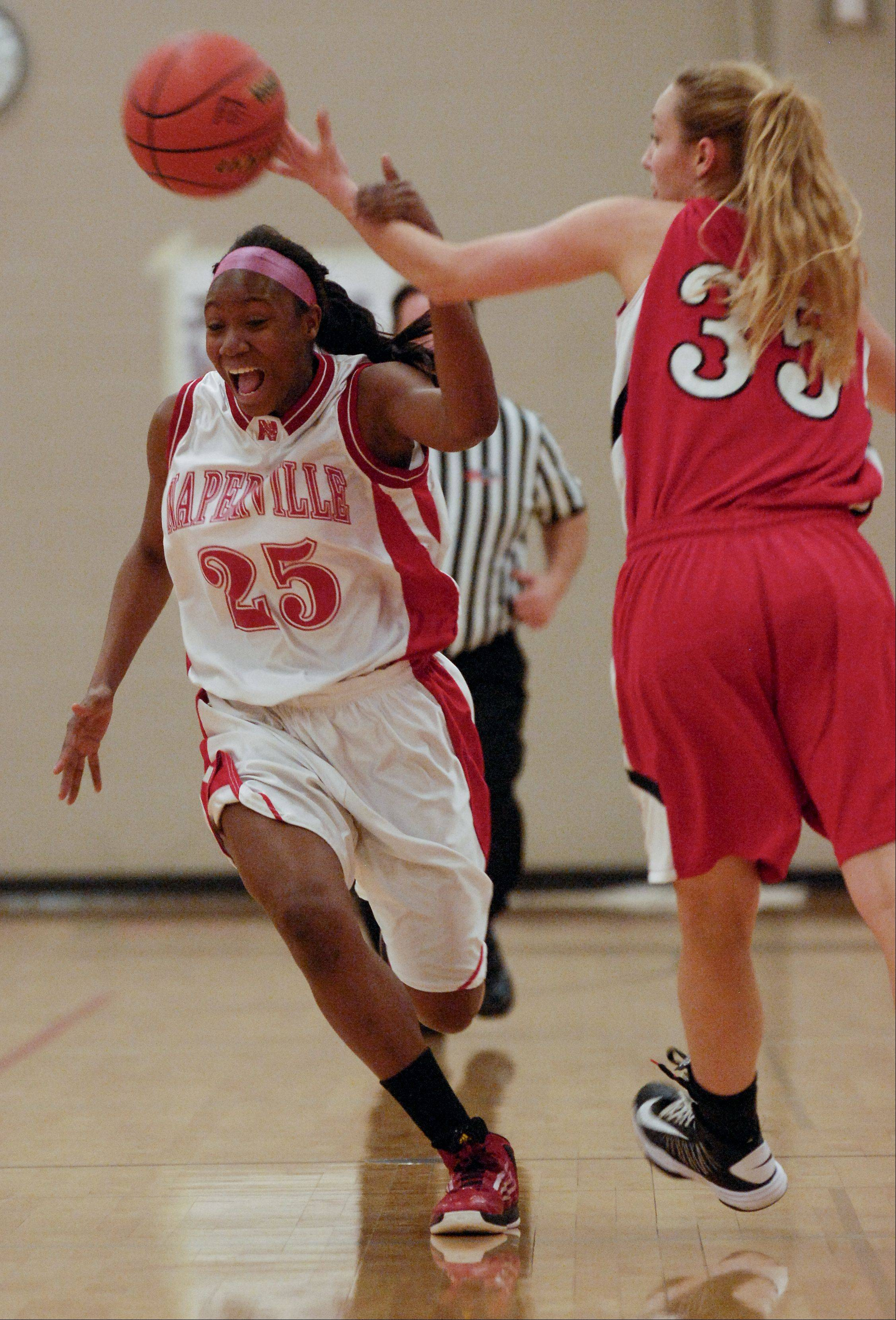 Cierra Stanciel of Naperville Central gives up control of the ball to Emily Eshoo of Benet Academy.
