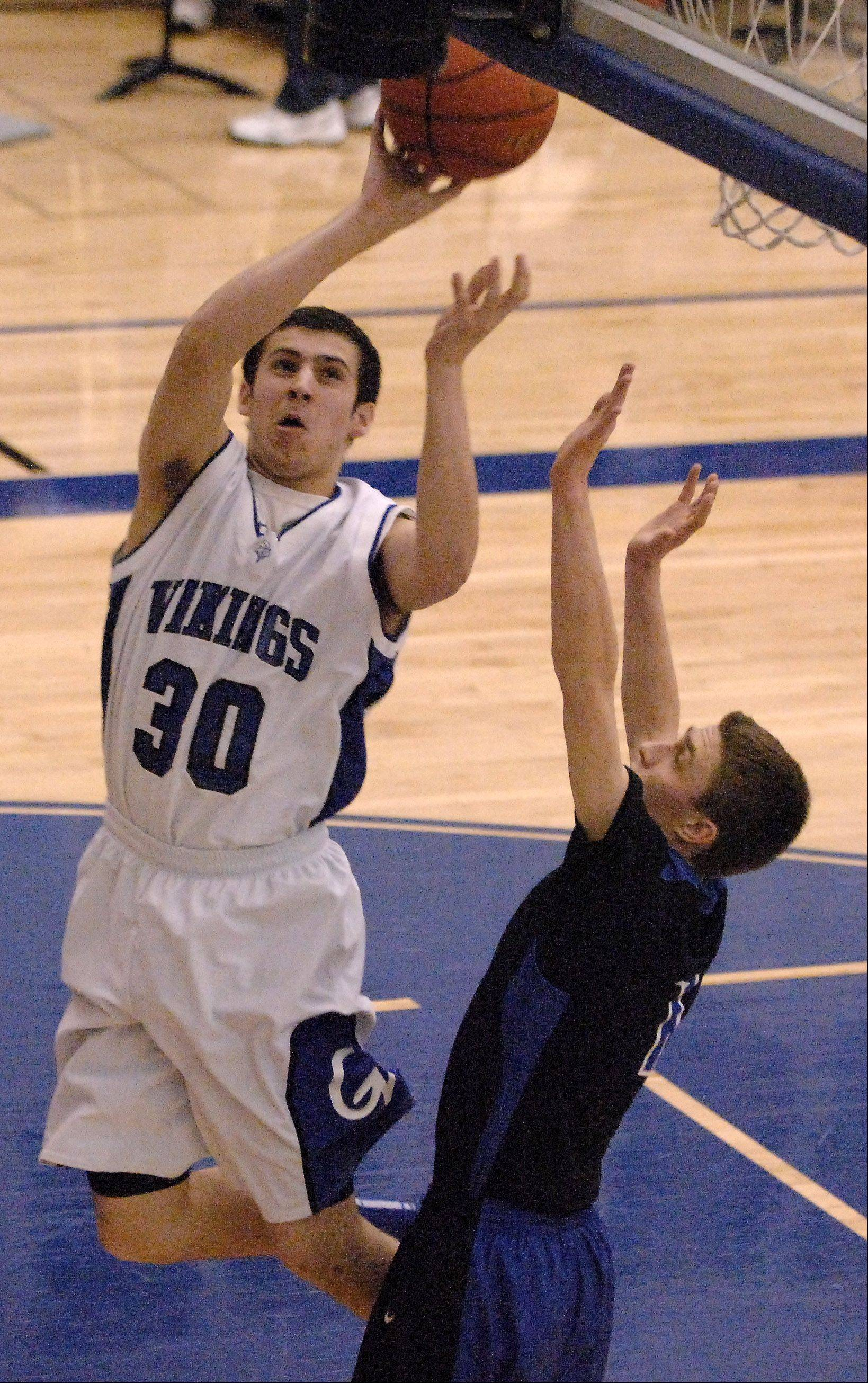 Geneva's Chris Parrilli scores and is fouled against St. Charles North during Friday's game in Geneva.