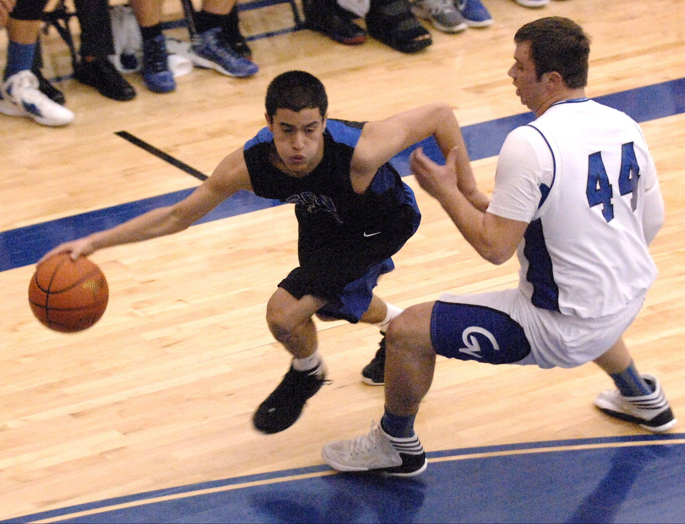 St. Charles North's Tony Neari drives past Geneva's Connor Chapman Friday in Geneva.