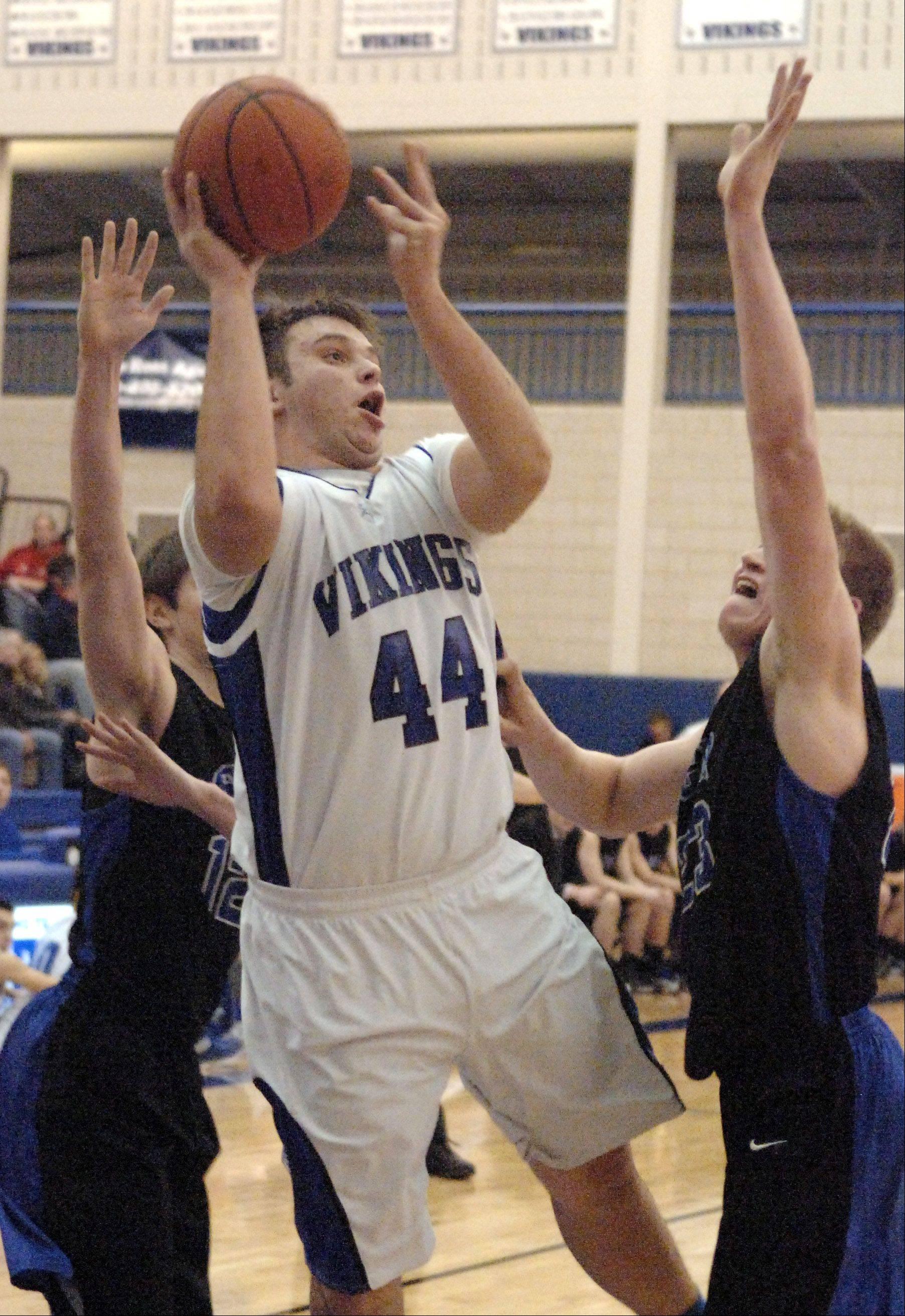 Geneva's Connor Chapman shoots and scores against St. Charles North during Friday's game in Geneva.