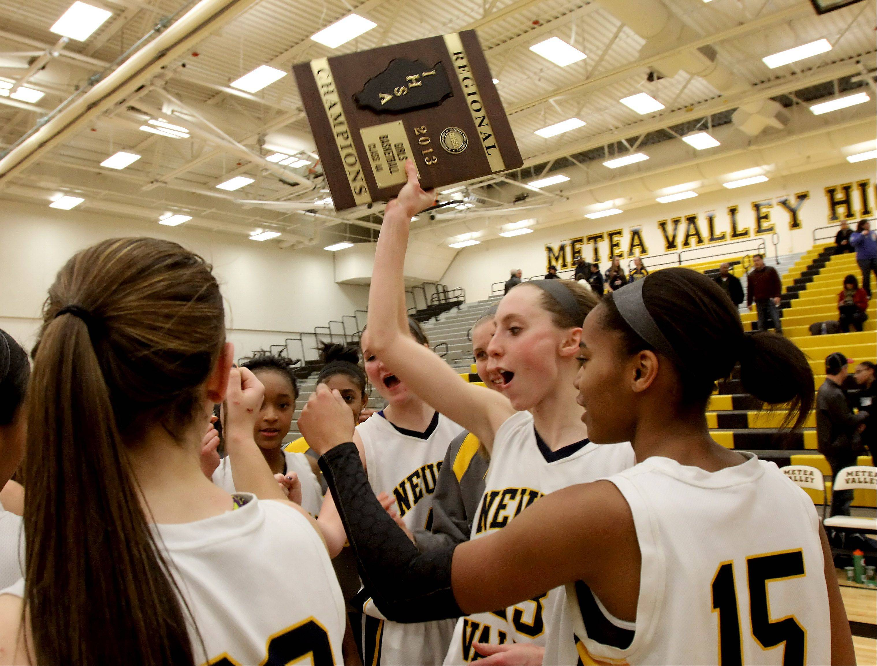 Neuqua Valley are regional champs in their win over Metea Valley in girls basketball Class 4A regional final on Friday in Aurora.