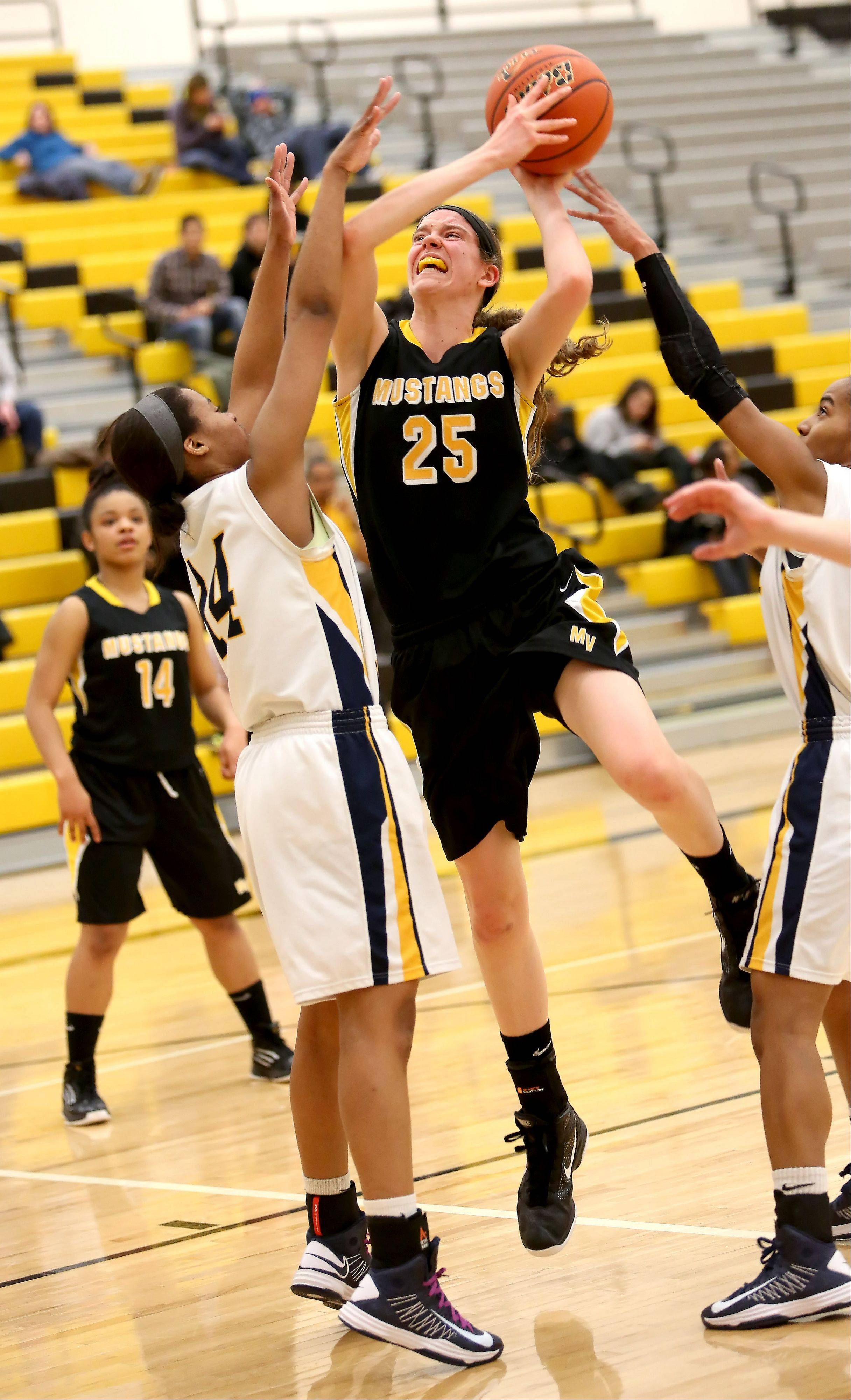 Lori Obendorf of Metea Valley tries for a basket as Najee Smith of Neuqua Valley defends in girls basketball Class 4A regional final on Friday in Aurora.