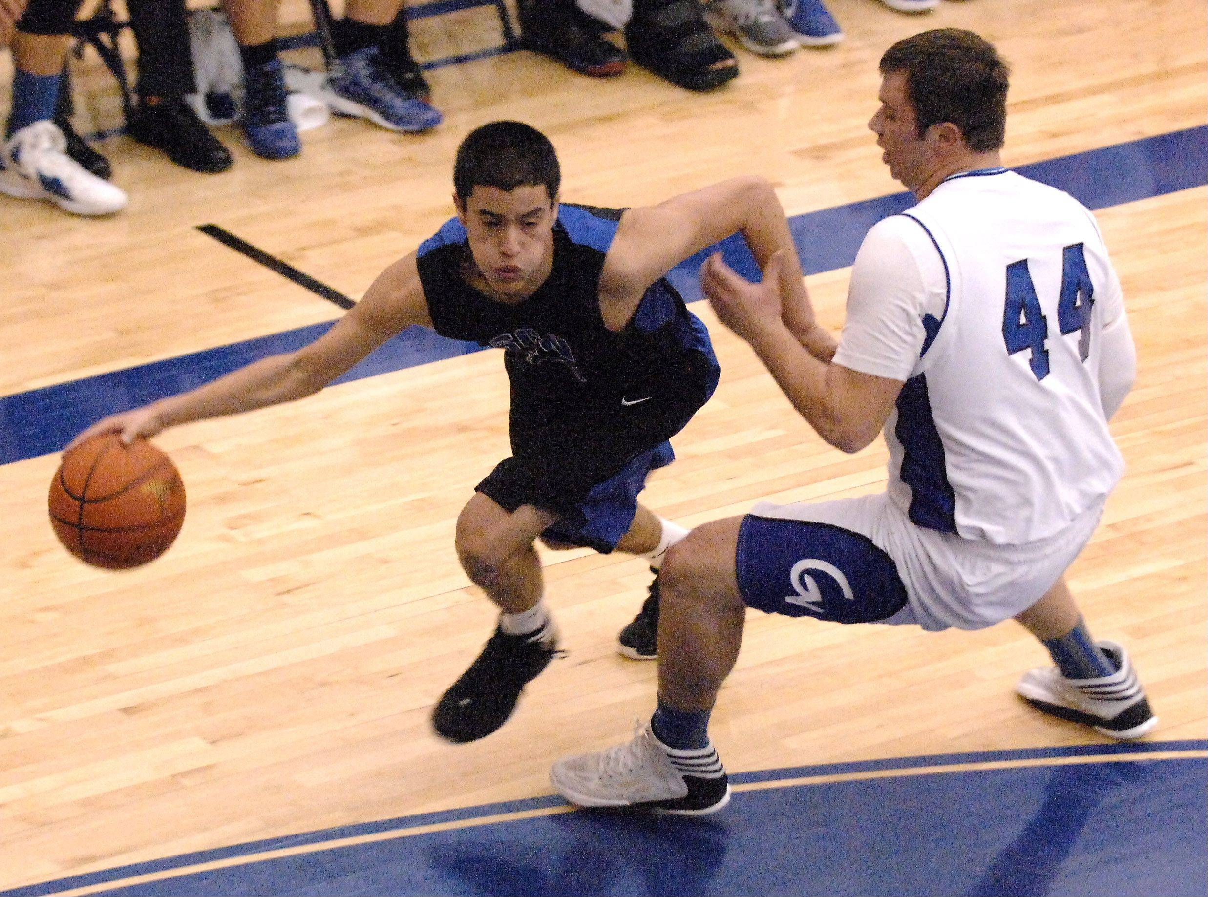 St. Charles North's Tony Neari drives past Geneva's Connor Chapman during Friday's game in Geneva.