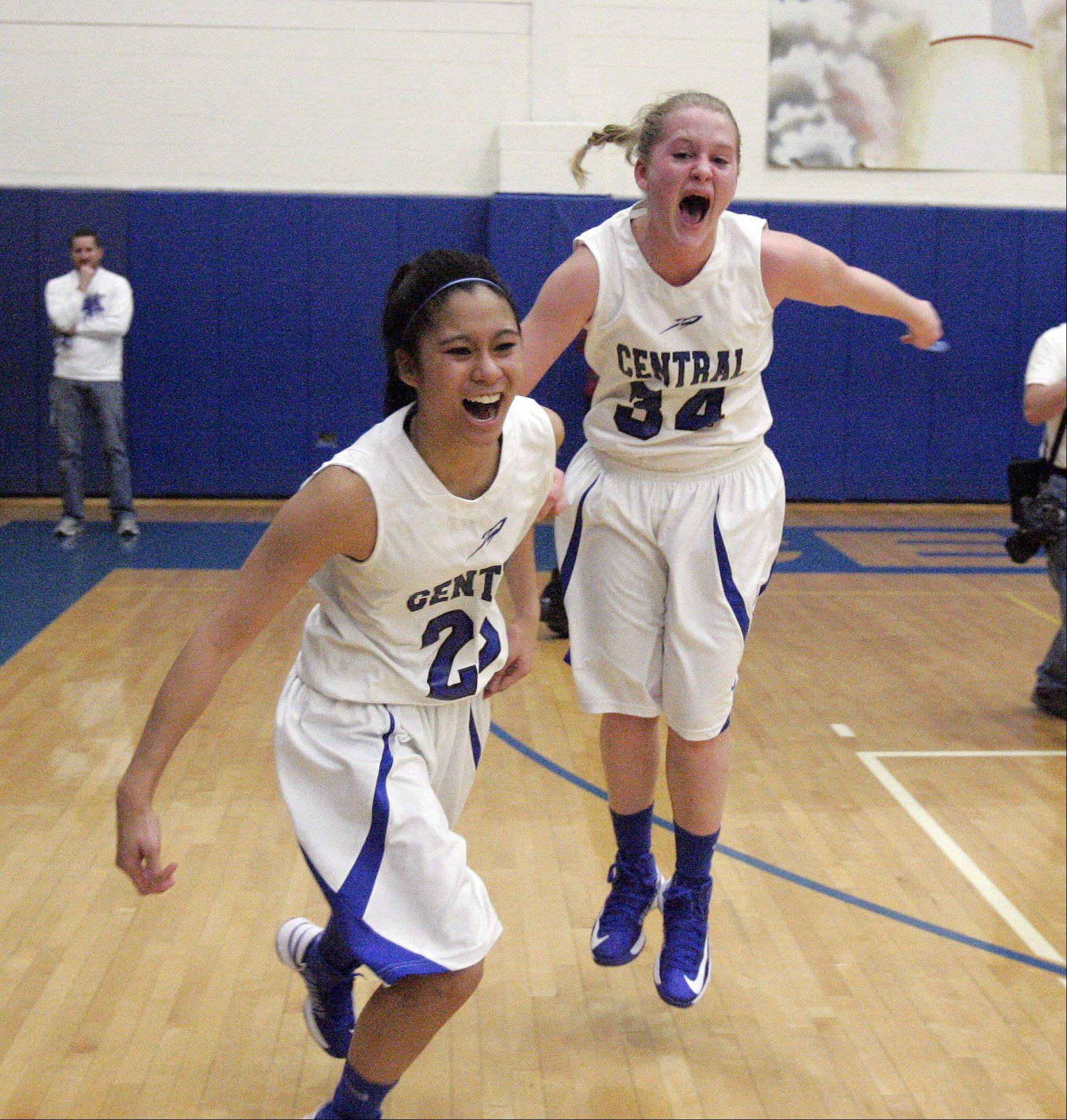Burlington Central's Camille Delacruz (23) and Samantha Pryor (34) Celebrate after Burlington Central beat Plano 38-34 for the IHSA Class 3A regional girls basketball championship Friday February 15, 2013 at Burlington.