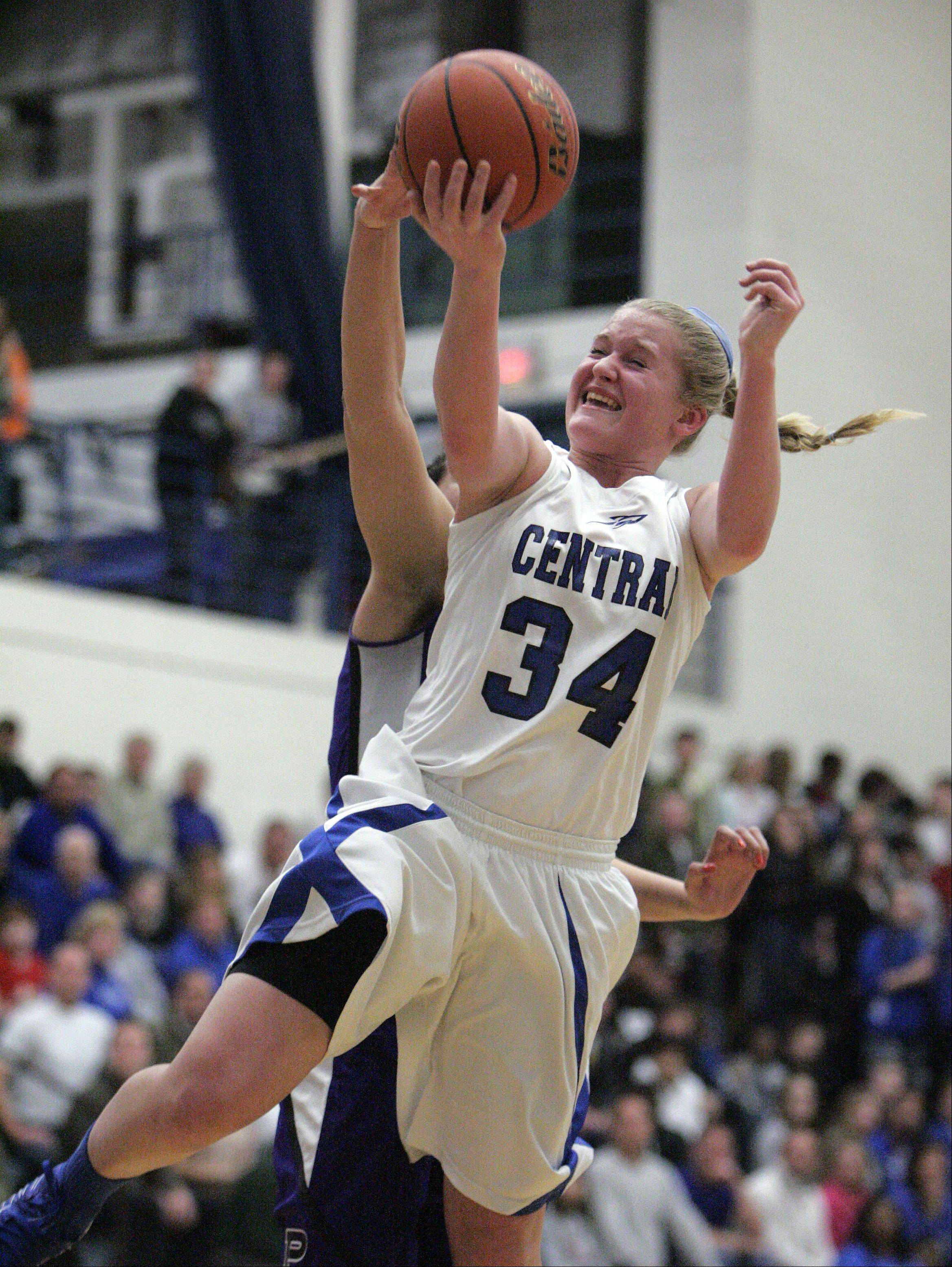 Burlington Central's Samantha Pryor (34) goes hard to the hoop during the second quarter of Burlington Central vs Plano for the IHSA Class 3A regional girls basketball championship Friday February 15, 2013 at Burlington. Central won the game 38-34, which was their first regional title win since 1990.