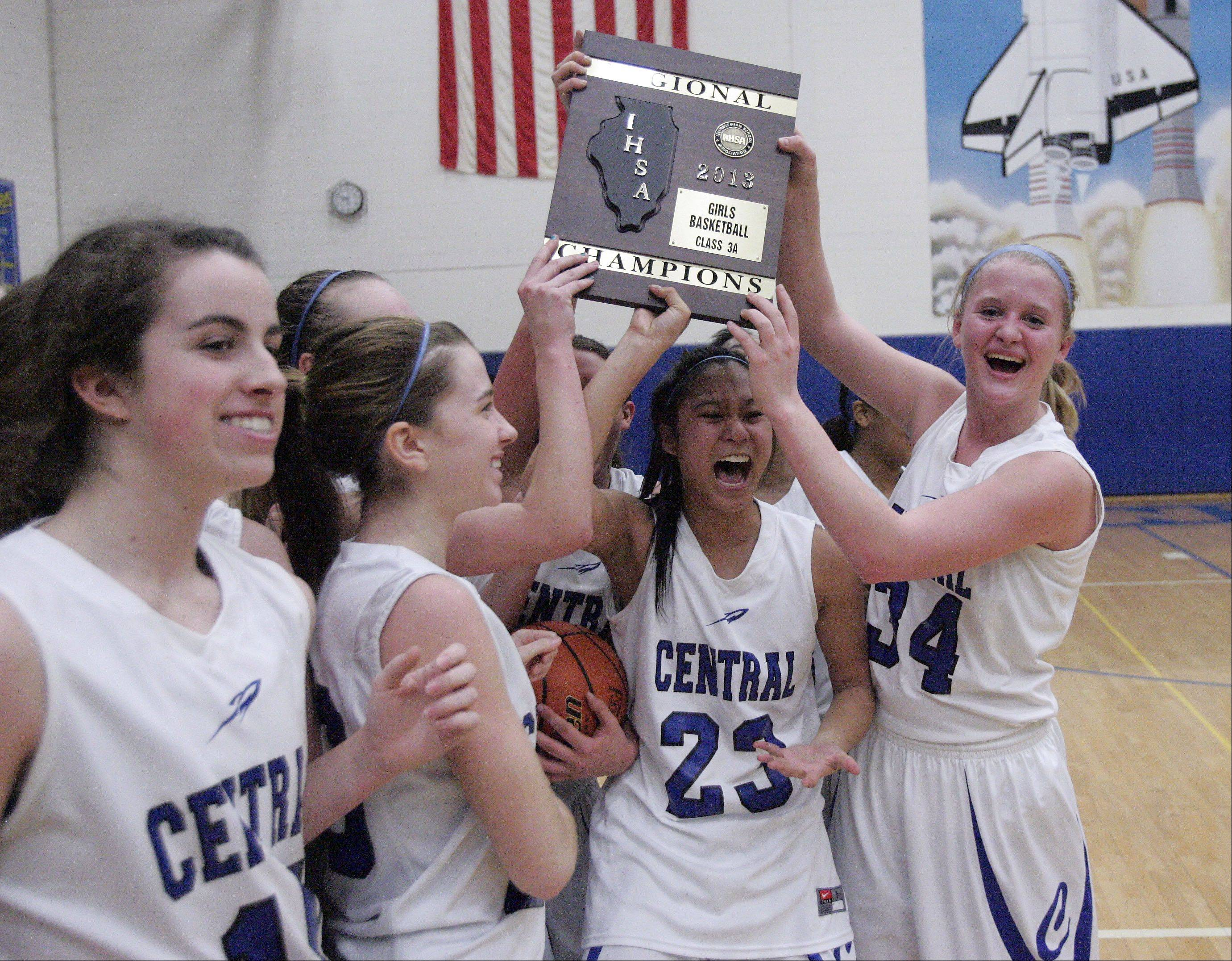 The team holds up the winning plaque after Burlington Central beat Plano 38-34 for the IHSA Class 3A regional girls basketball championship Friday February 15, 2013 at Burlington.