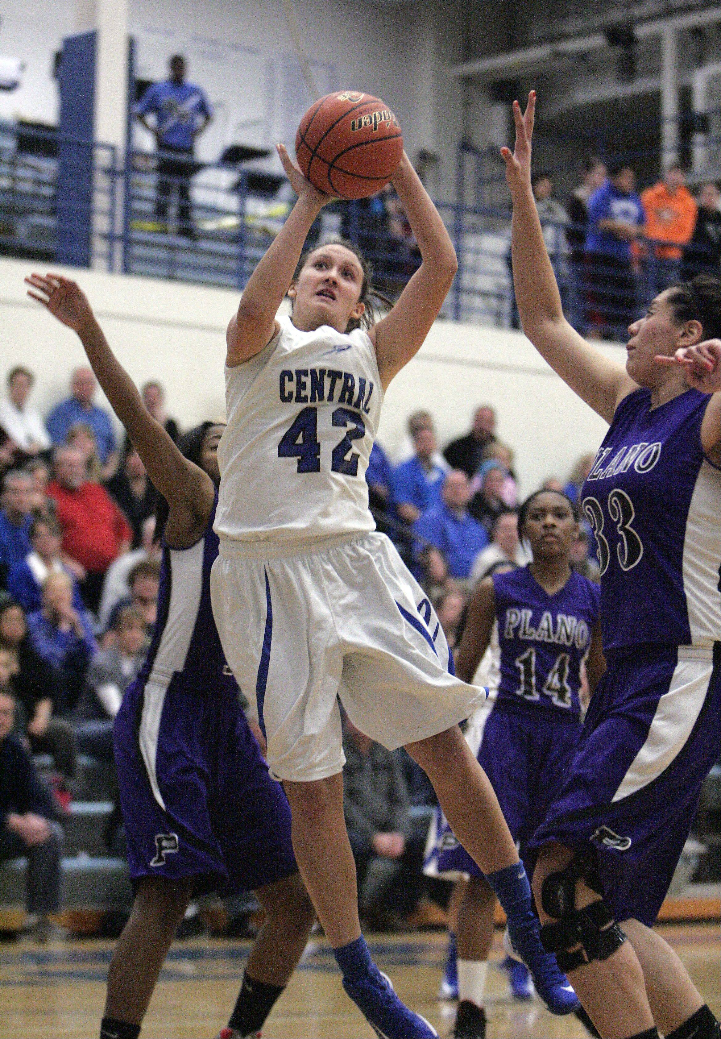 Burlington Central's Alison Colby (42) goes hard to the hoop past Plano's Clarisa Martinez (33) during the first quarter of Burlington Central vs Plano for the IHSA Class 3A regional girls basketball championship Friday February 15, 2013 at Burlington. Central won the game 38-34, which was their first regional title win since 1990.