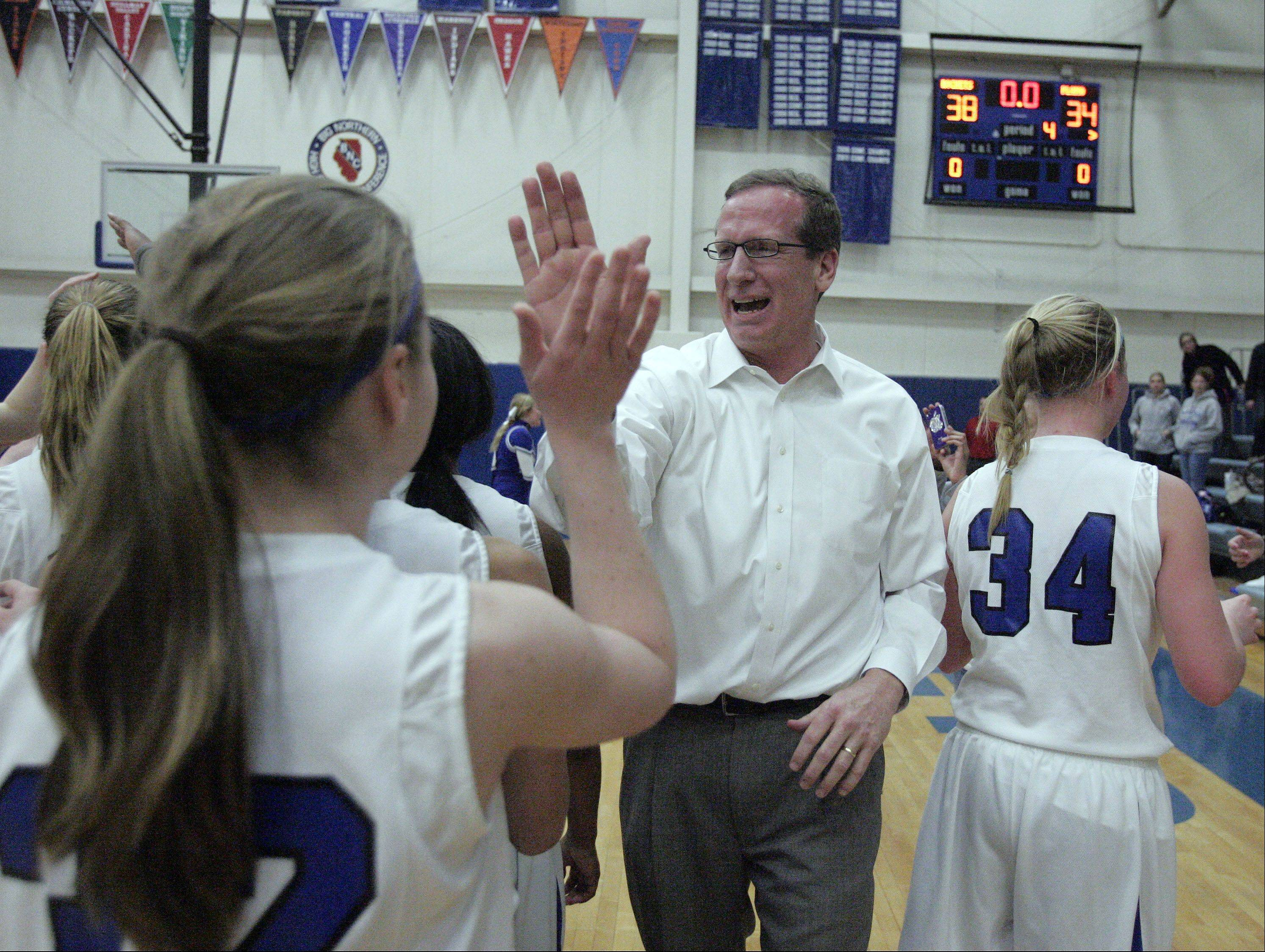 Burlington Central girls basketball coach Mark Smith celebrates the Rockets' Class 3A regional championship win over Plano Friday night.