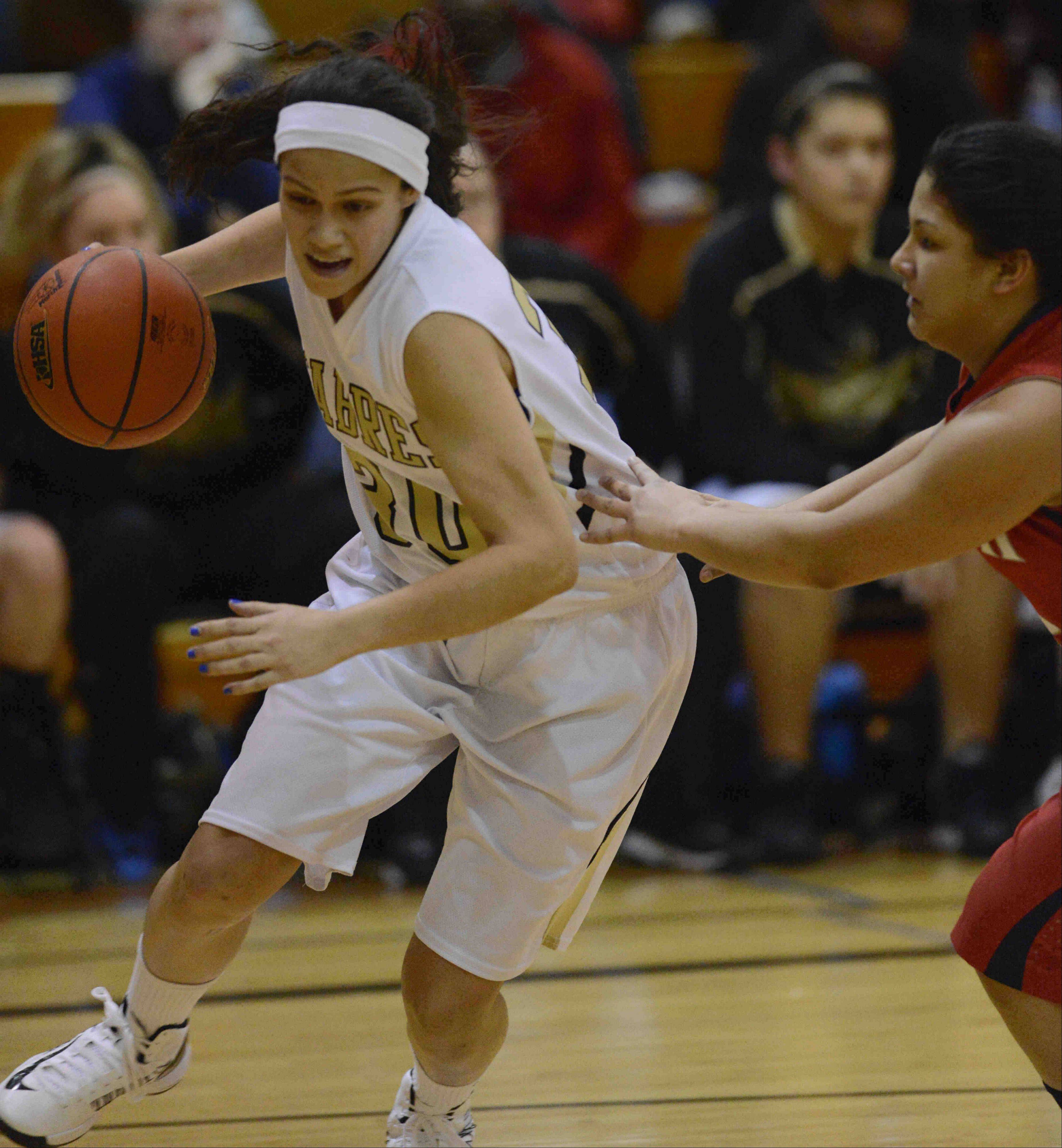 Streamwood senior Jessica Cerda, left, drives against South Elgin's Nadia Yang during the Sabres' regional final win.