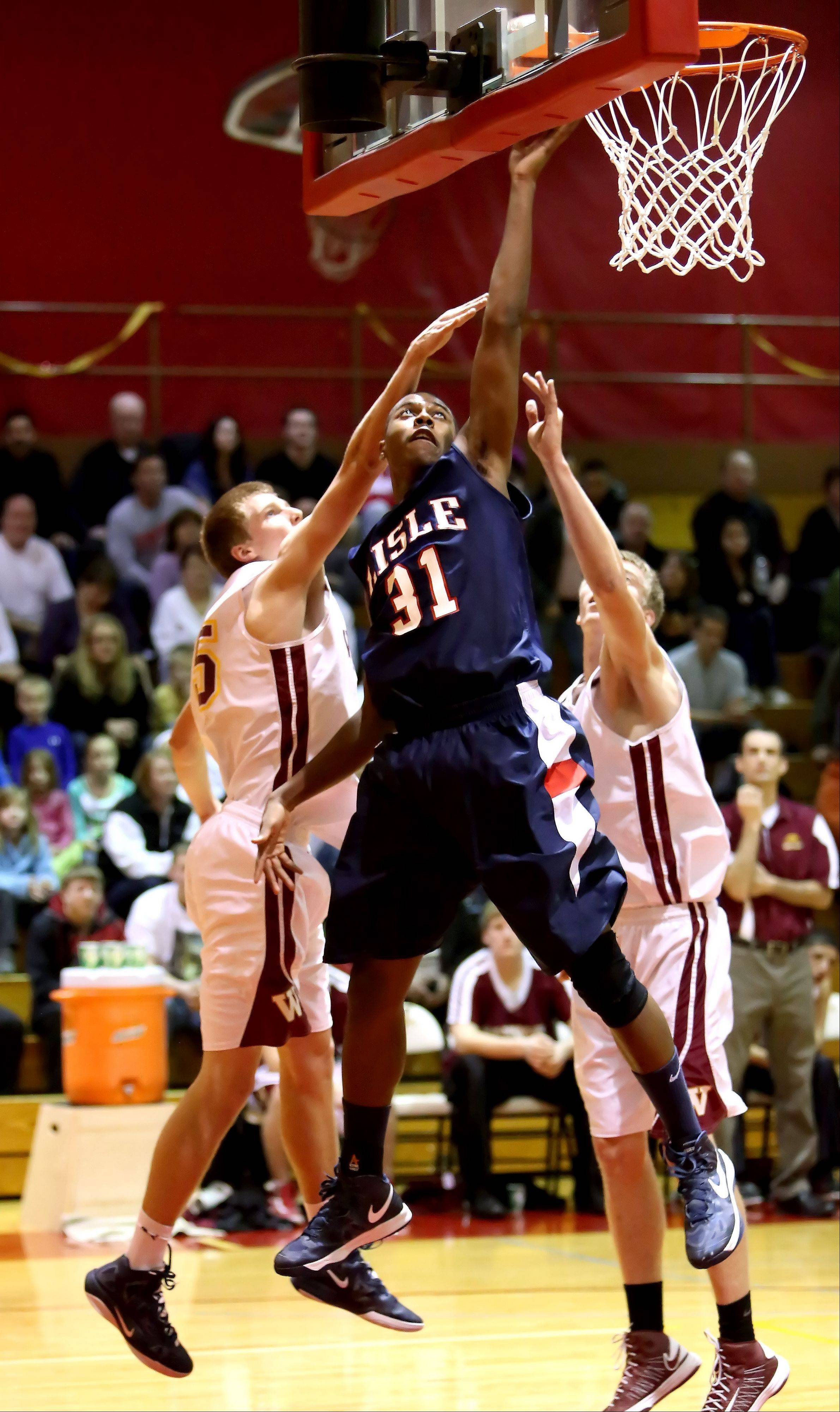 Lamont Ross of Lisle goes up for two points in action against Westmont in Class 2A regional boys basketball on Monday in Westmont.