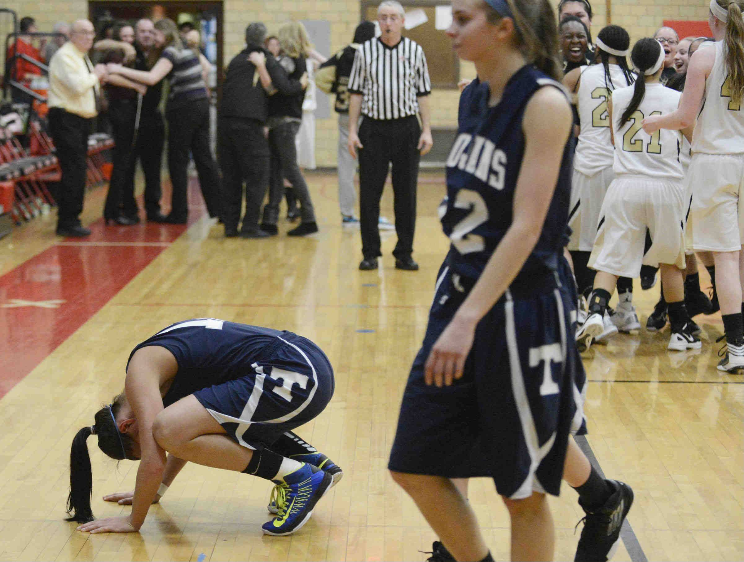 Cary-Grove's Joslyn Nicholson falls to the floor at the end of the Trojans' loss to Streamwood Monday in the Class 4A sectional game in Rockford.