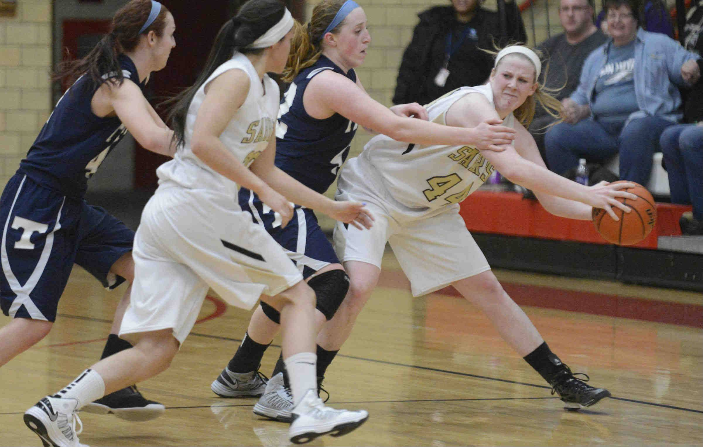 Streamwood's Hannah McGlone keeps the ball away from Cary-Grove's Olivia Jakubicek with seconds to play Monday in the Class 4A sectional game in Rockford.
