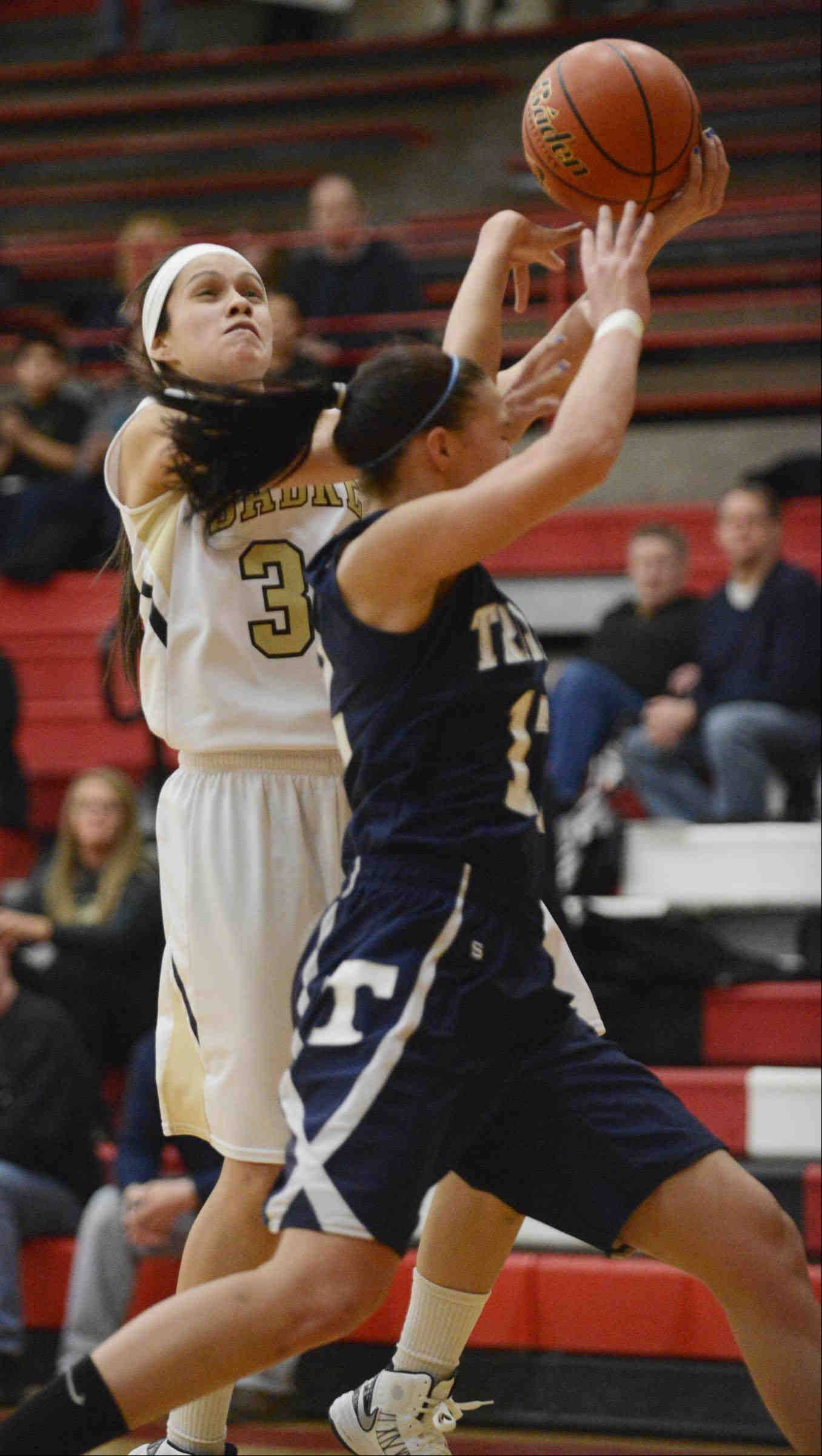 Cary-Grove's Joslyn Nicholson intentionally fouls Streamwood's Jessica Cerda Monday in the Class 4A sectional game in Rockford.