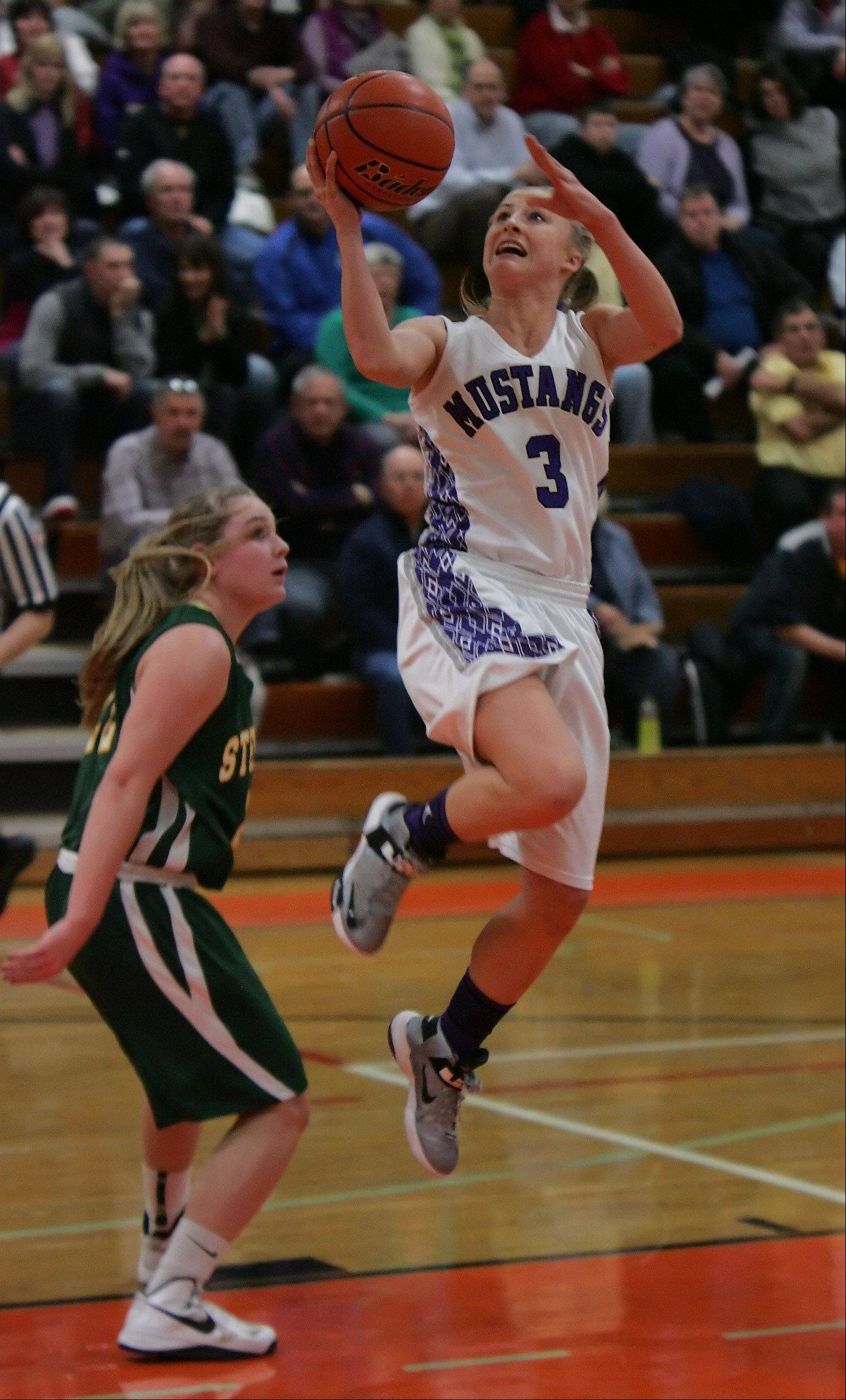 Rolling Meadows guard Jackie Kemph drives for a layup against Stevenson guard Kari Moffat during the girls basketball game between Rolling Meadows and Stevenson in the Class 4A sectional semifinals at Libertyville High School Monday. Kemph was the leading scorer in the game with 23 points.